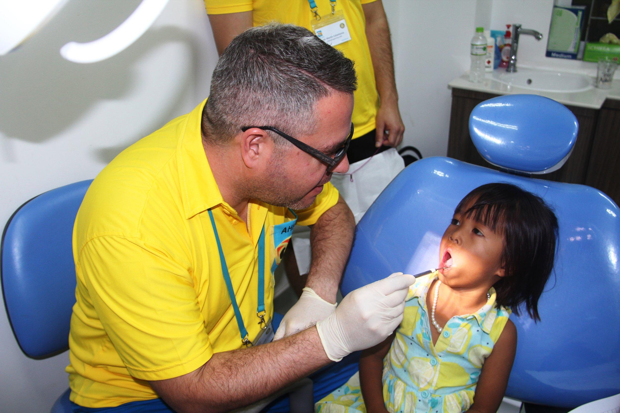A young patient receiving dental treament