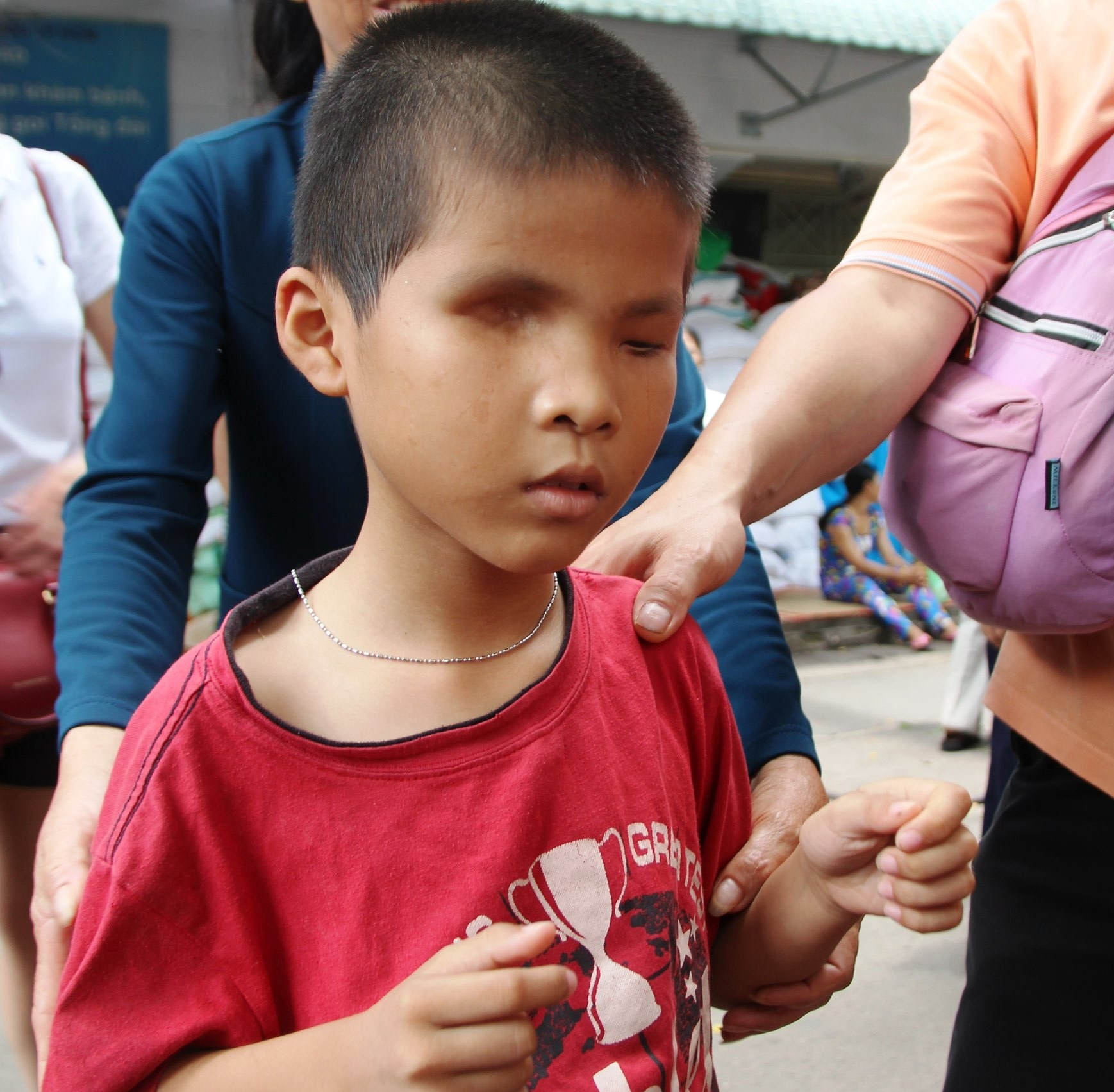A village boy receiving food package