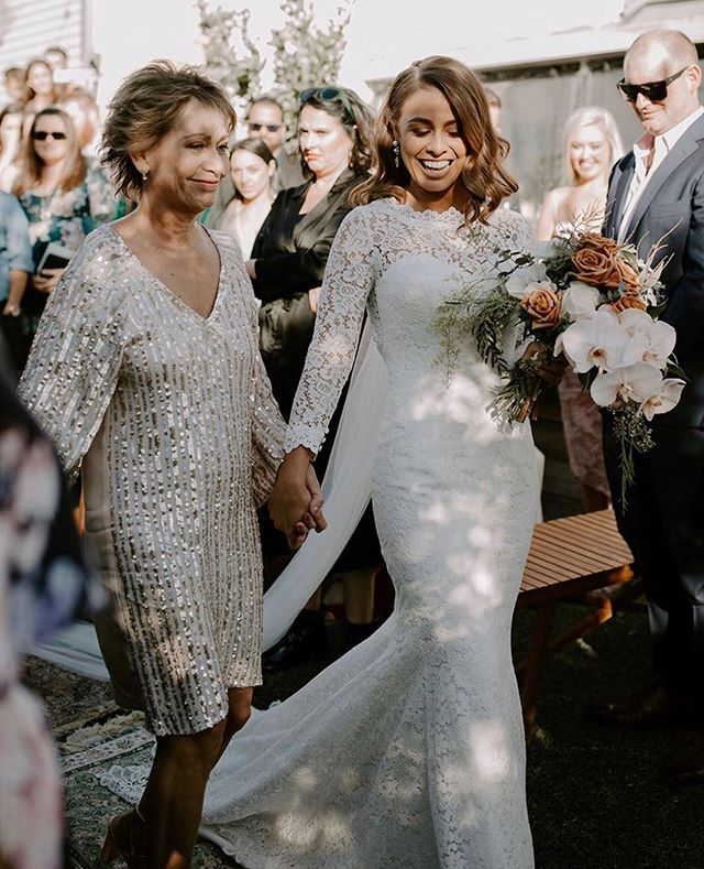 The beautiful @allanah.jay with her mama walking her down the aisle in her customised @whiteaprilbridal gown 💐 to know more about customised gowns contact us at sales@cizzybridal.com  . .  . . . #whiteaprilbridal #cizzybridalaustralia #vintagebride #vintagemodern #modernbride #independentbride #uniquebride #weddingphotography #weddingstyle #engaged #whitelace #bridetobe #brideandgroom #justengaged #bridalgown #bohowedding #bohogown