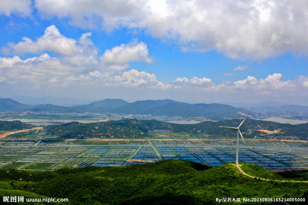 A wind turbine overlooks fields in Hengqin New Area, Guangdong Province.