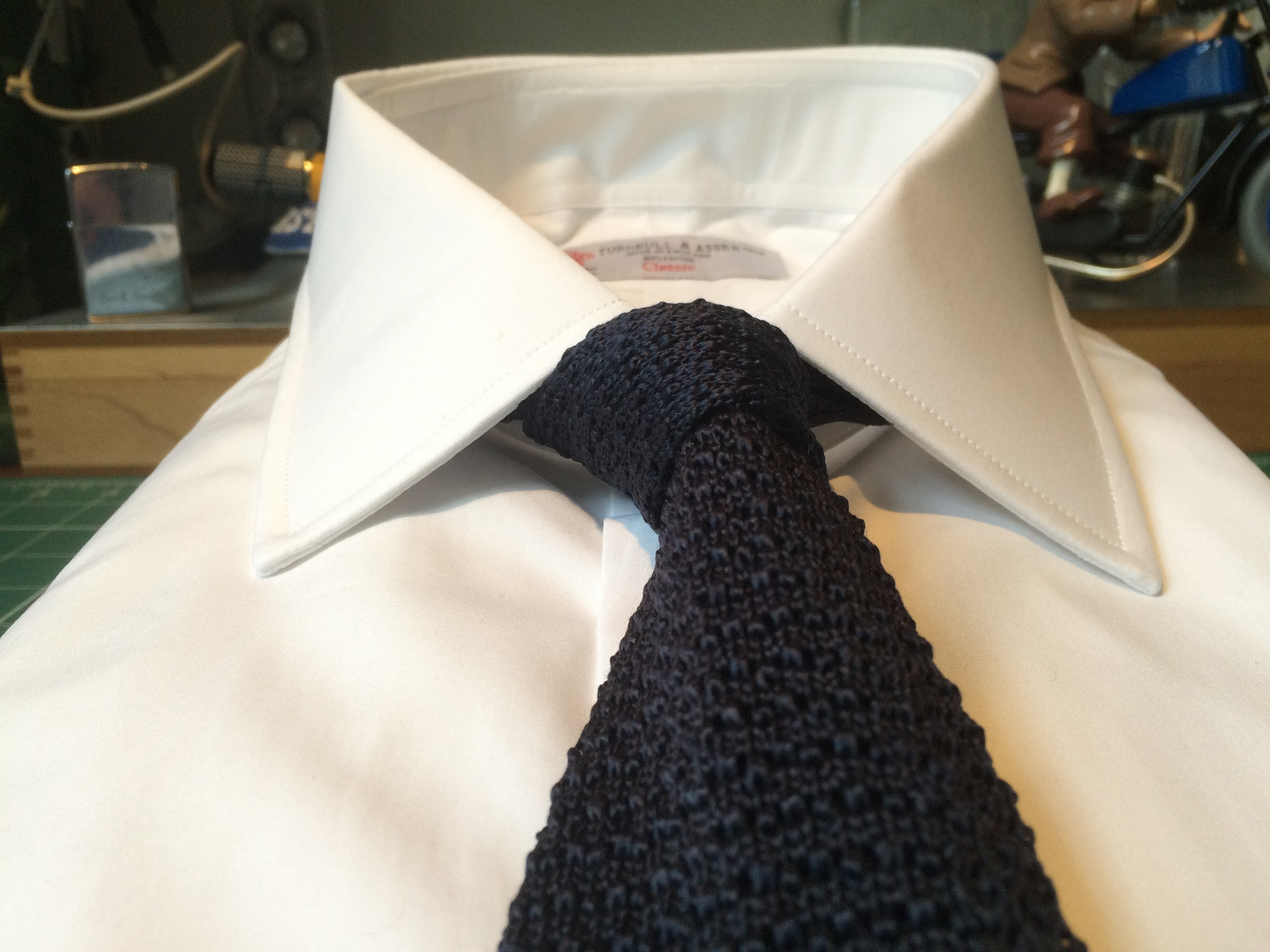 T&A's distinctive cutaway collar with T&A knitted silk tie