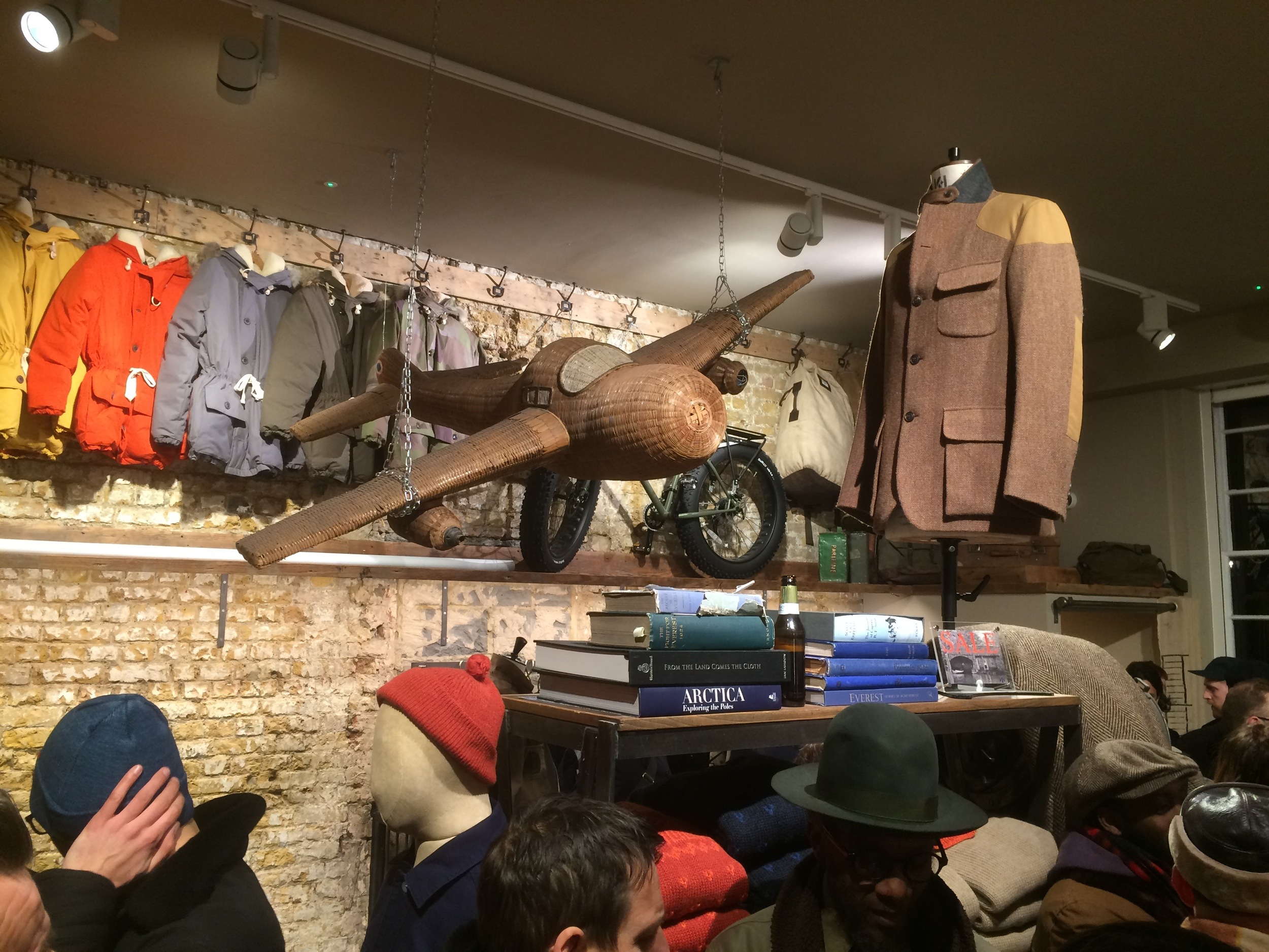 Wicker glider, Mallory classic jacket and Antarctic Parkas hanging on the wall.