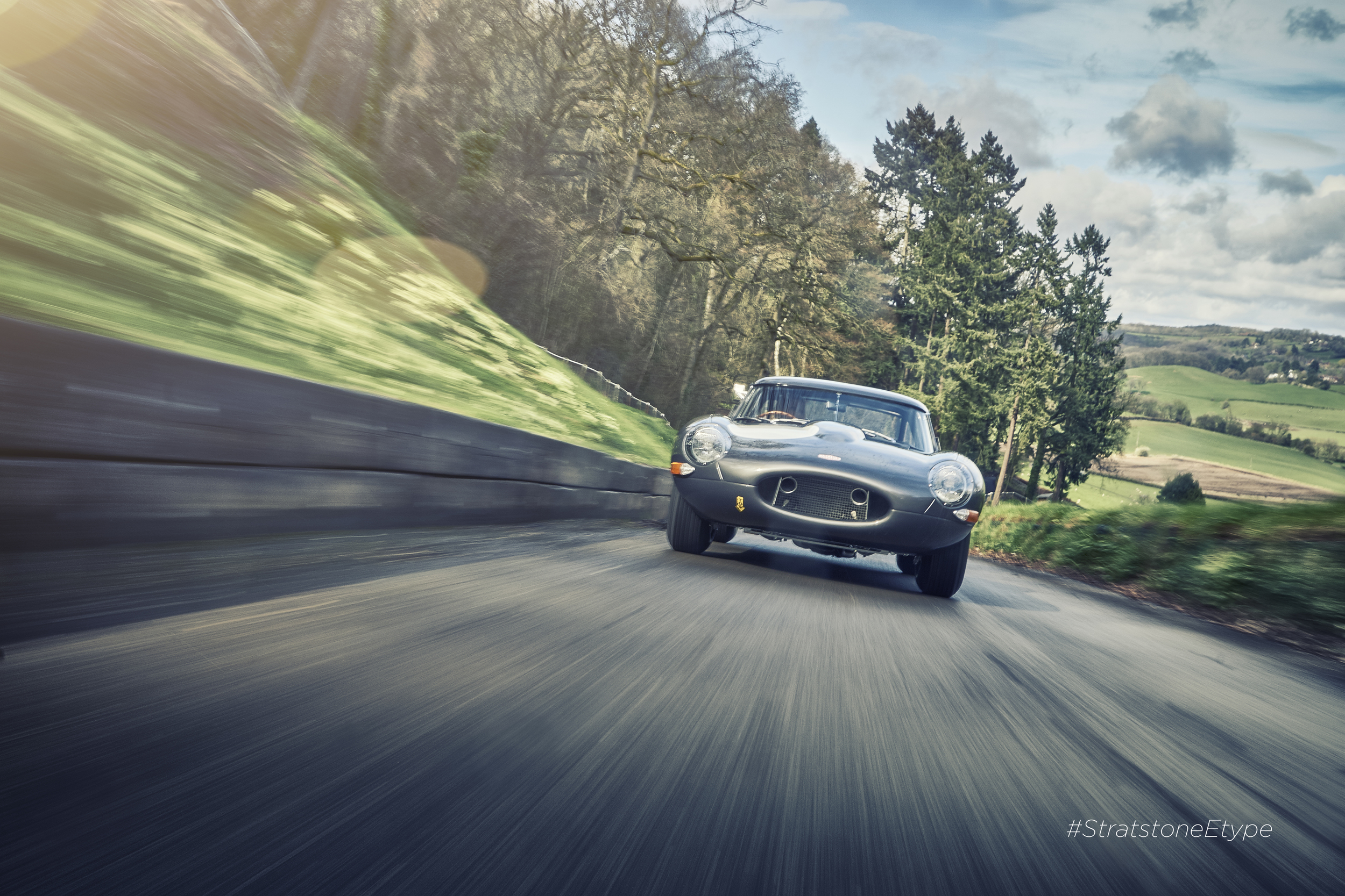 Lightweight E-Type being gunned up Shelsley Hil Climb on its first outing from the factory.