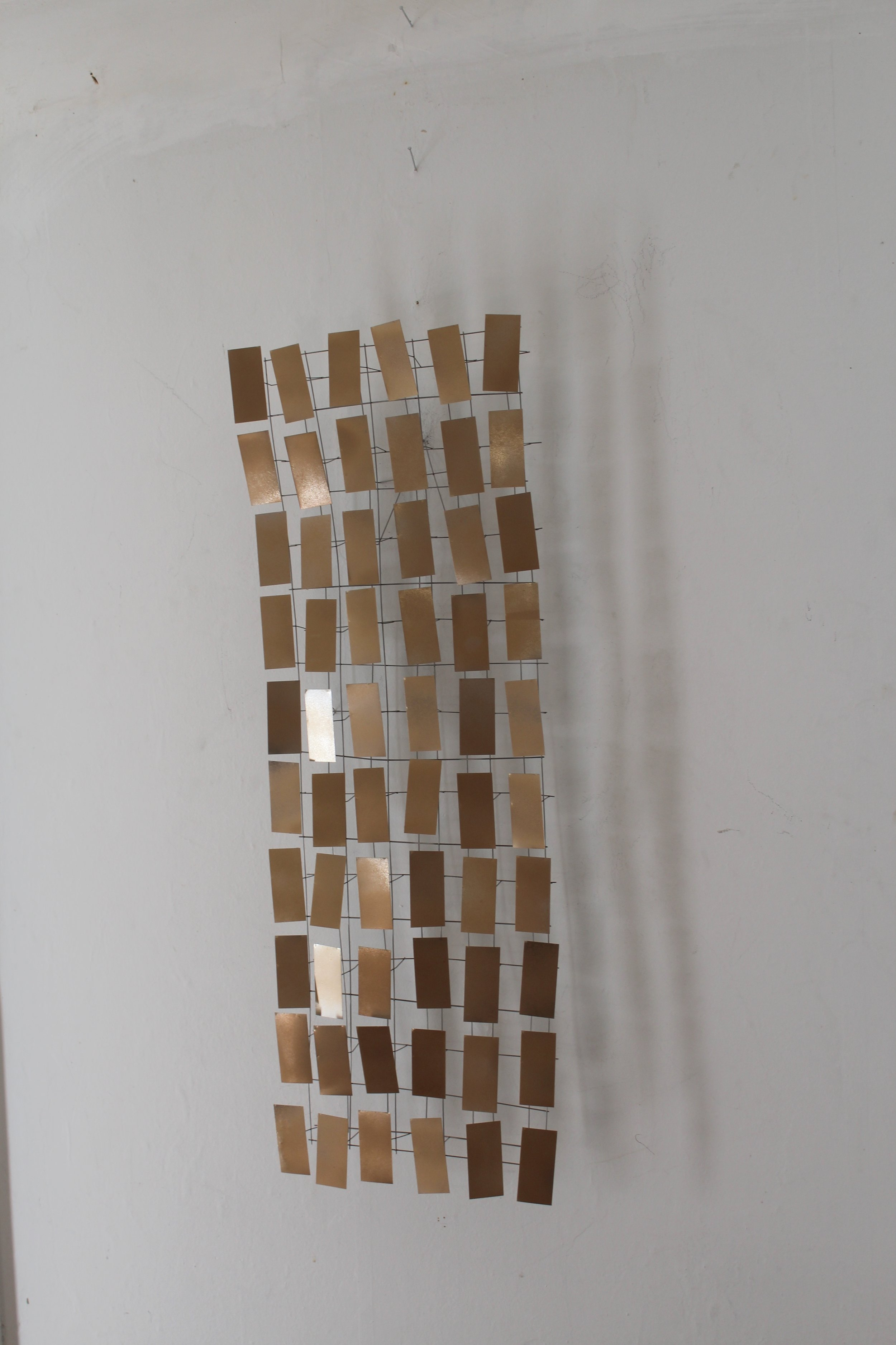 All Gold  Painted aluminum ad stainless steel 30 x 11 x 3 inches