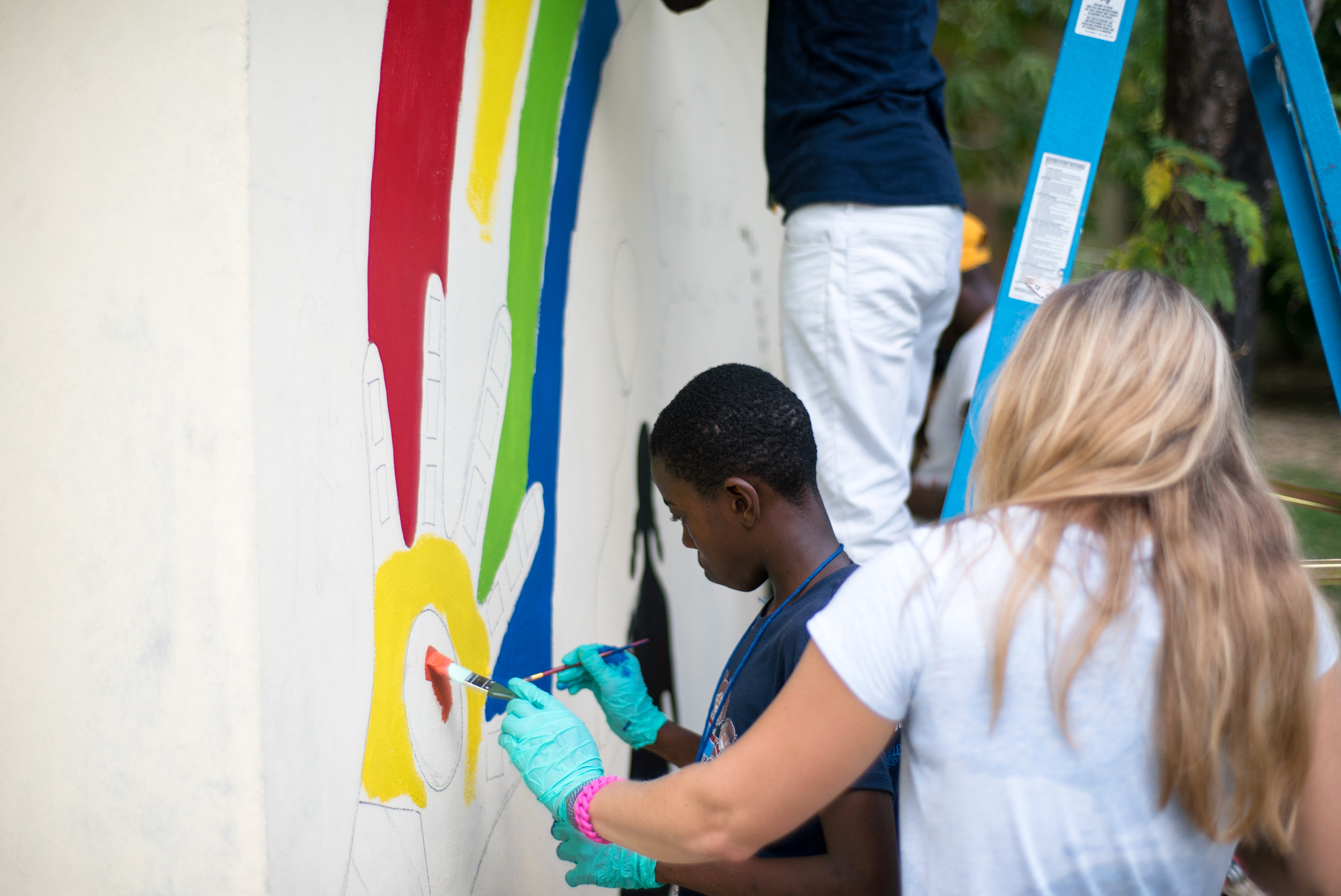 Painting the kiyès ou ye mural on the Summits campus!