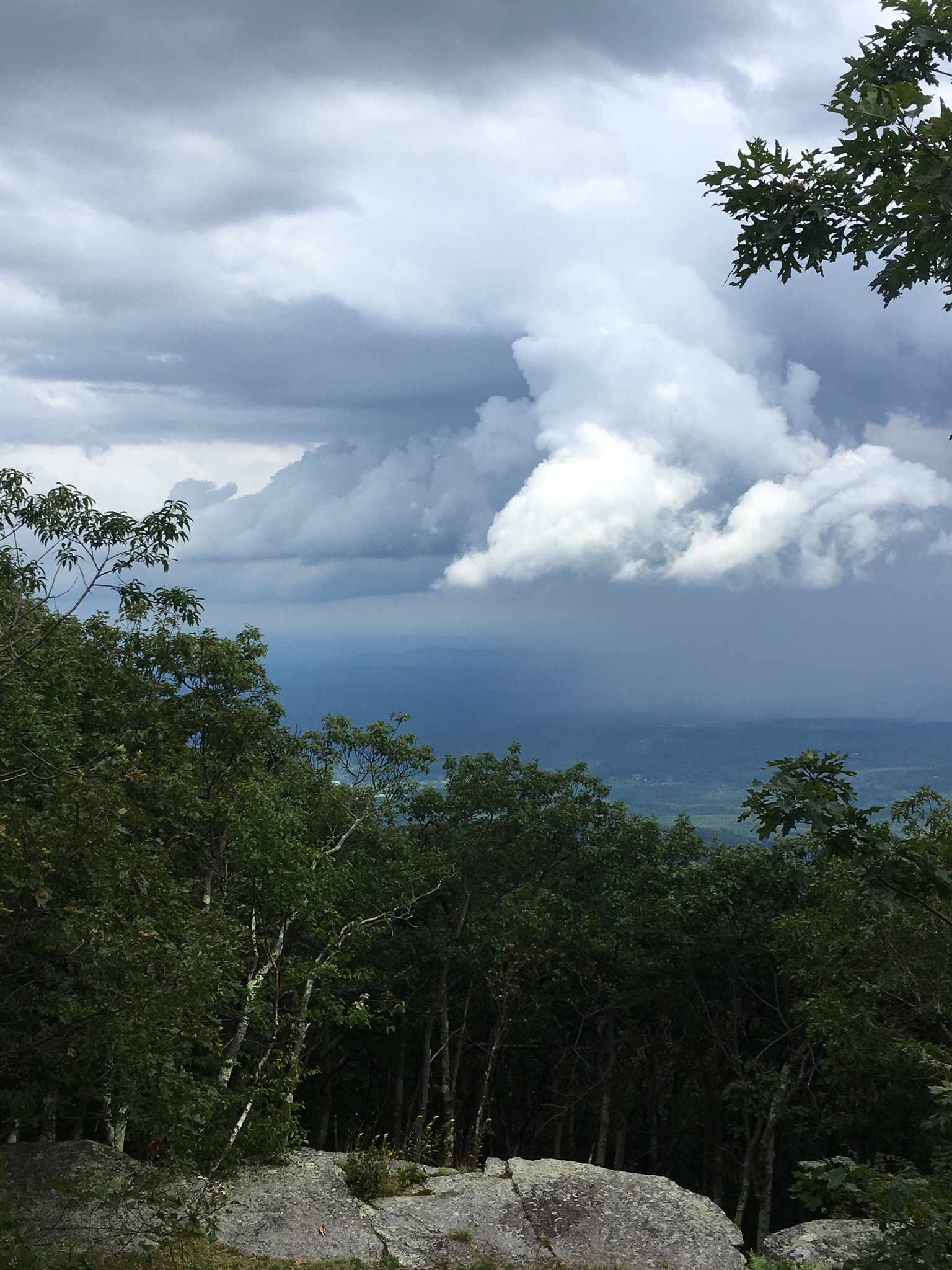 Even on sunny days, afternoon mountain weather can be unpredictable. Prepare to leave a summit or ridgeline in the event of an approaching storm.