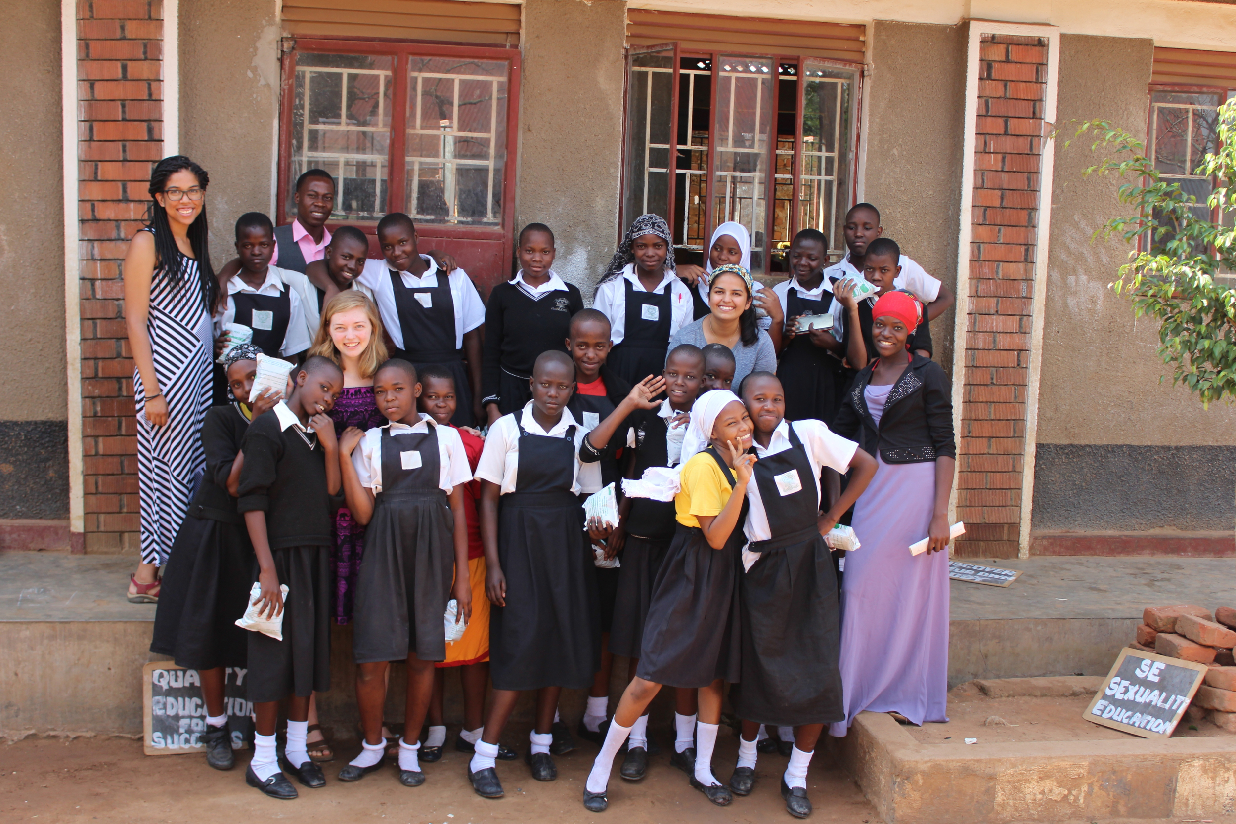 Iganga Central students posing with their new 1.5 year supply of reusable, eco-friendly pads as a part of the Menstrual Dignity Project