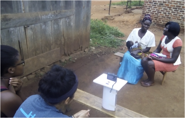 Rachel, a fellow UDHA intern, surveying a woman about her nutrition practices.