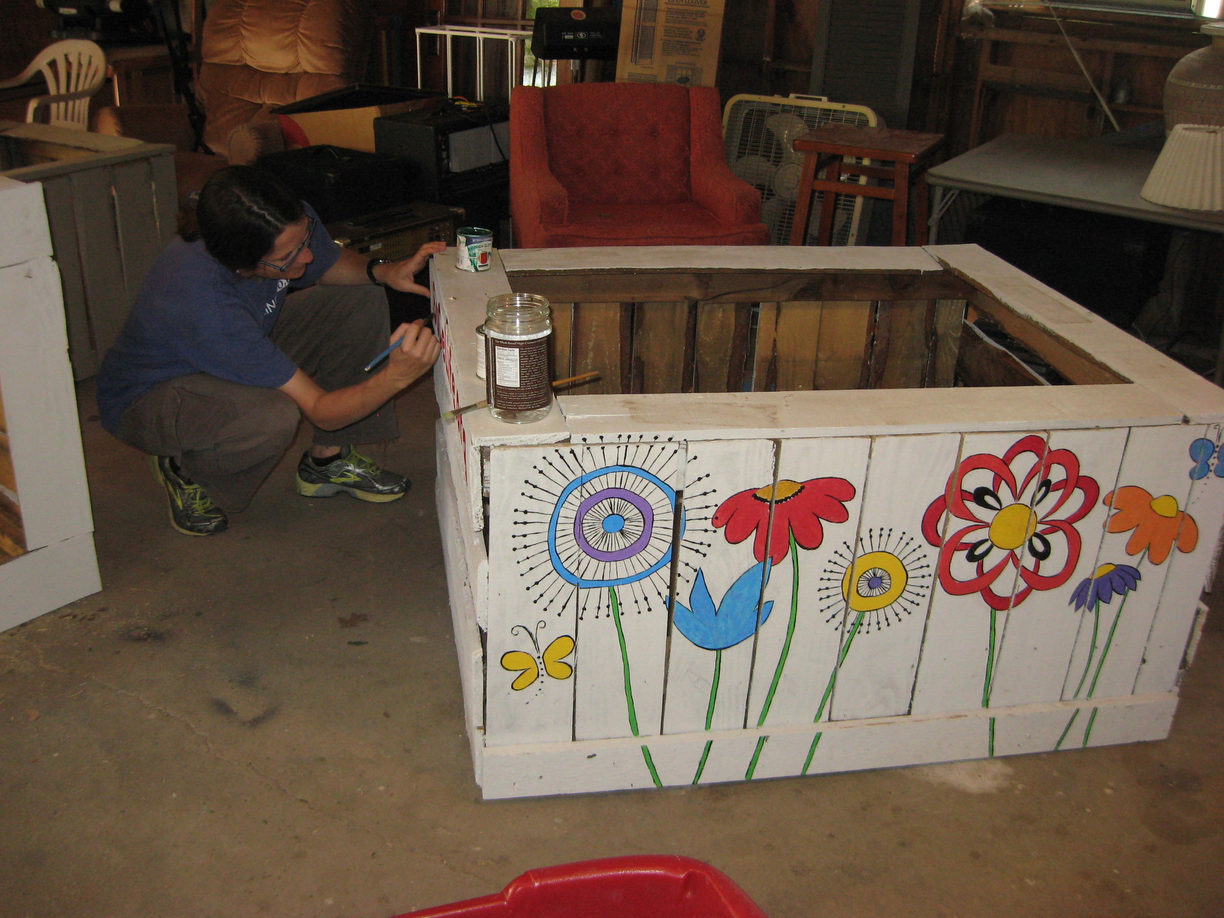 I'm painting the logo on the side, and the front of the box has been painted by Kristin (one of our summer interns).