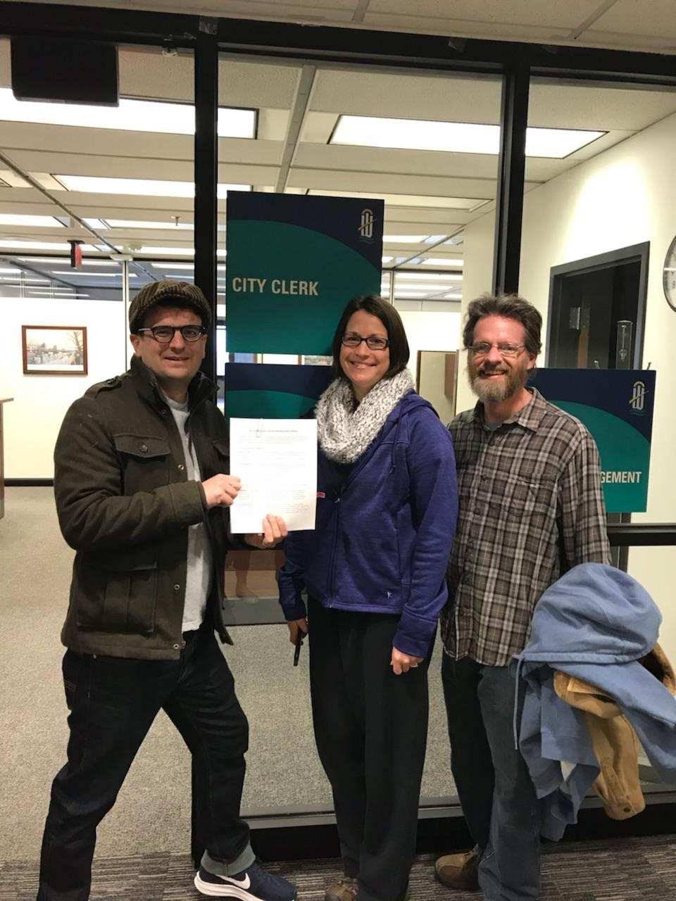 Our team, pictured here with the official paperwork, is ready to get started.