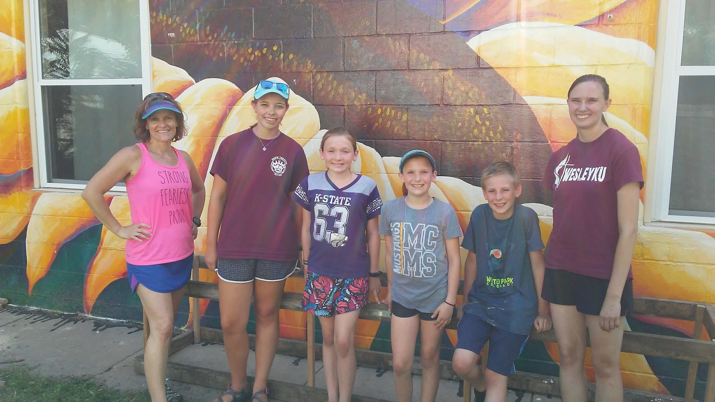 The traditional group photo in front of the beautiful sunflower mural!