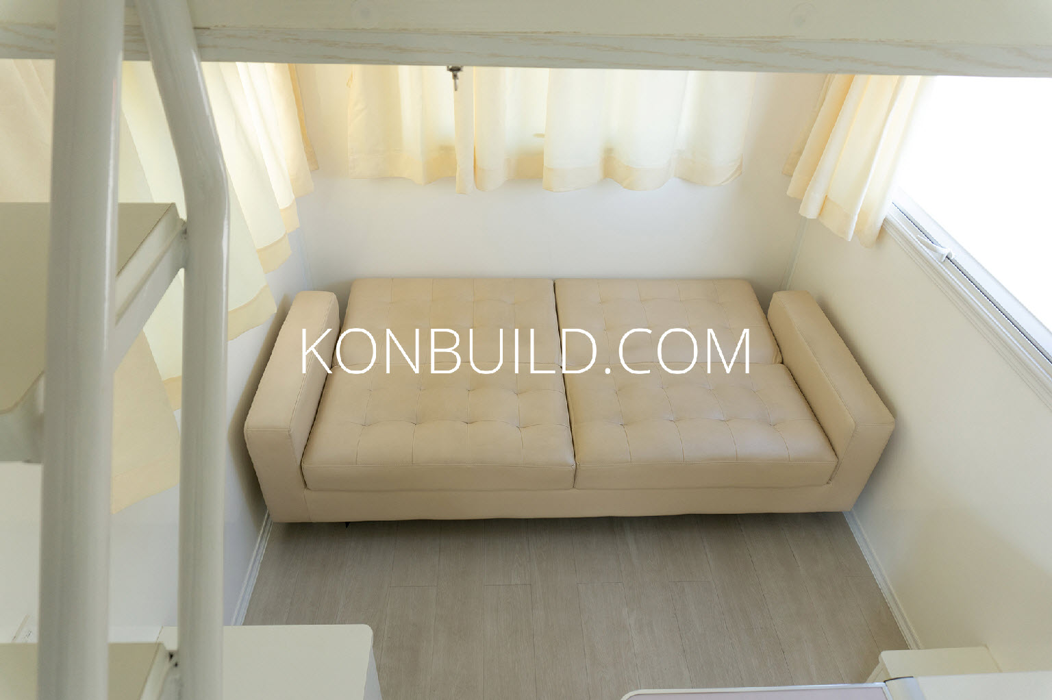 Fold out lounge suite pictured down stairs.
