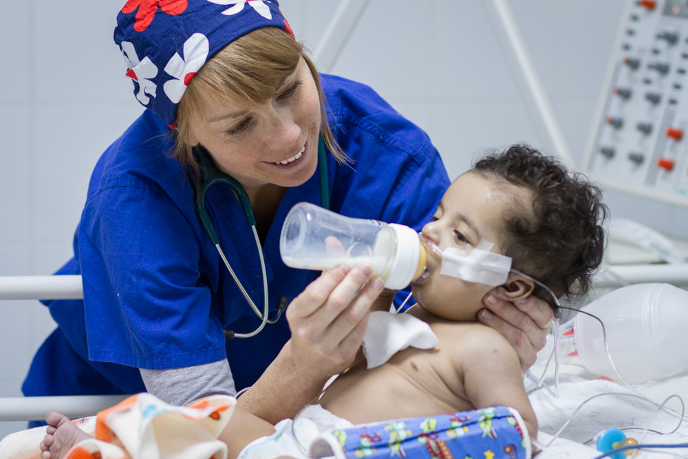 Nurse Libby giving a bottle.jpg