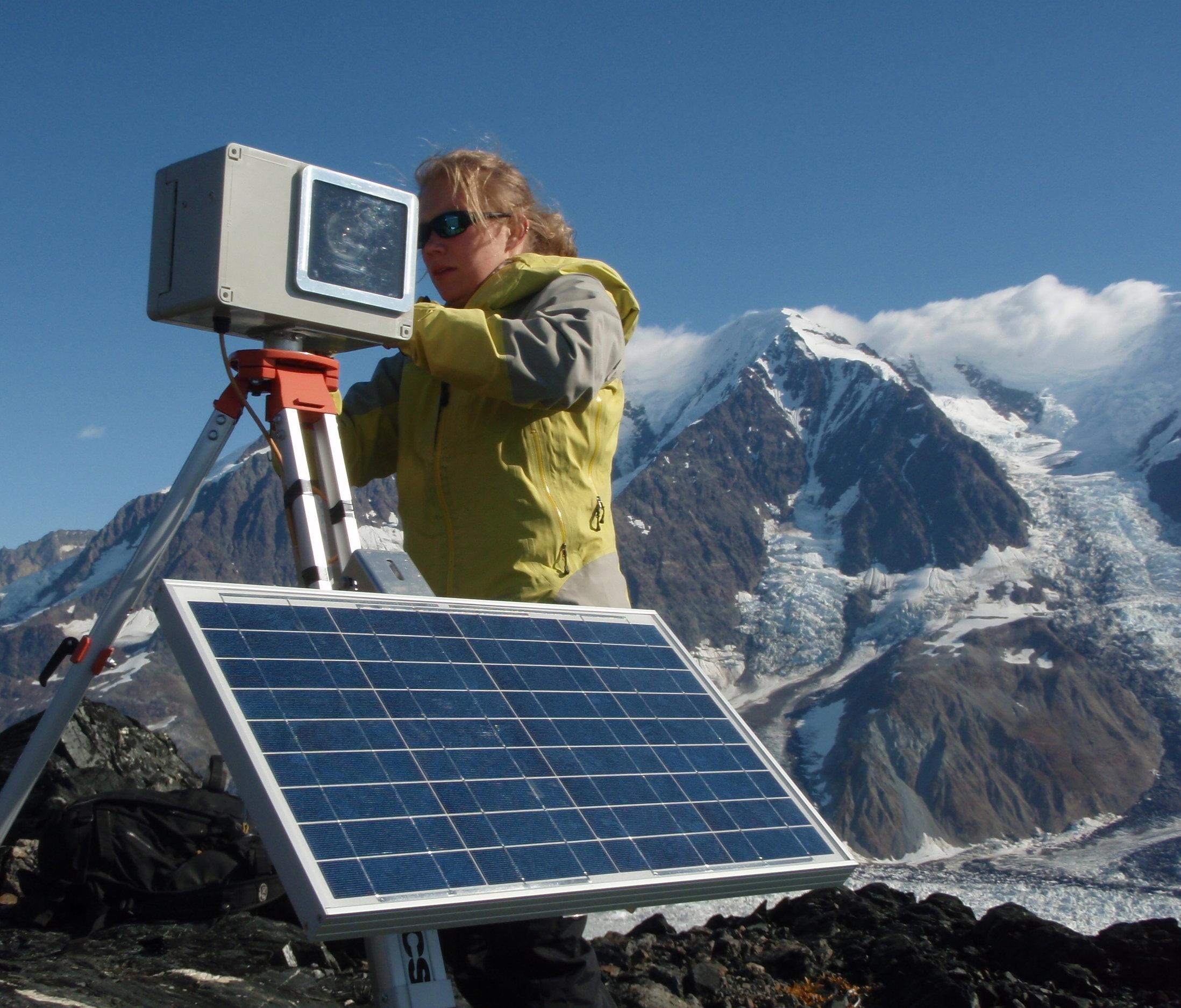Kristin Schild servicing a time-lapse camera to monitor the Hubbard Glacier (Alaska, 2011). Photo by Gordon Hamilton