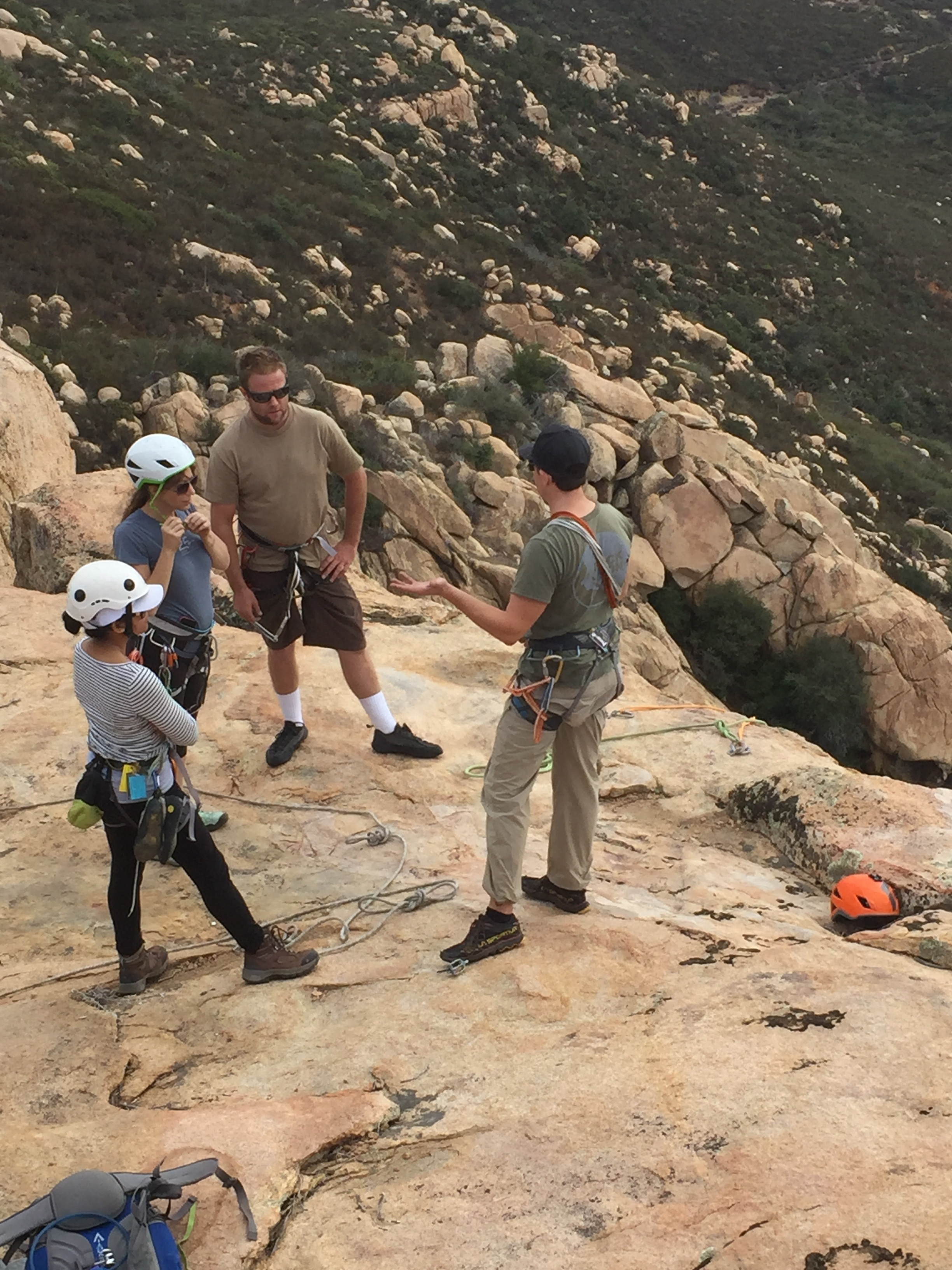 AAC Instructor Tom Vokes talks equalizing anchors and rappelling to AAC Members Melissa Angeles, CJ Hutchens and Toby Hutchens.  Photo cred: Piotr Andrzejczak.