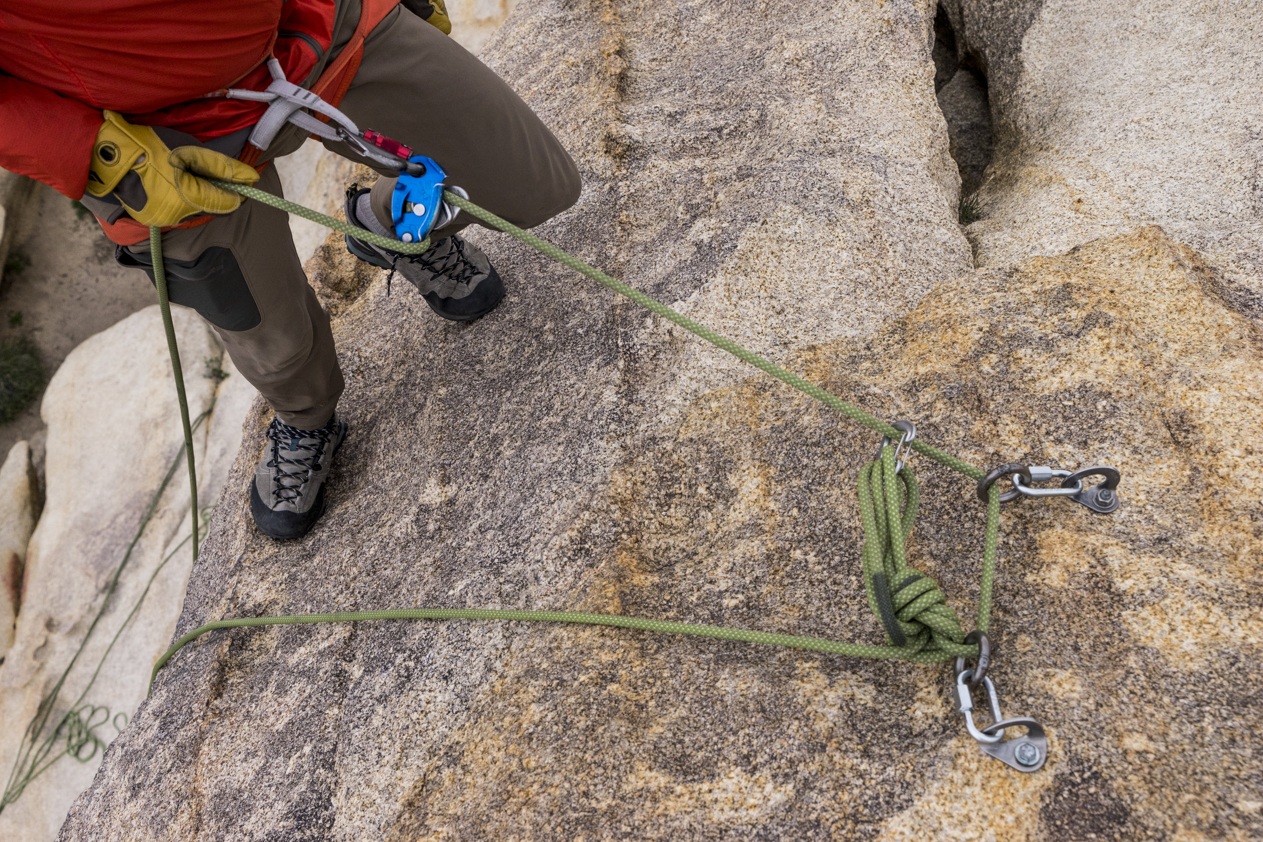 """When a single strand of rope is fixed, blocked, or counterweighted, an ABD can be used for rappelling.  """"Rappelling with GRIGRI takes training, and it is important to system check ensuring proper rigging and connection.""""-Petzl"""