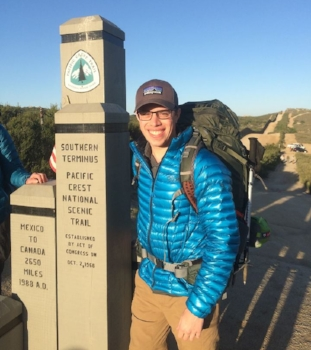 Marcus at the start of the Pacific Crest Trail by the U.S.-Mexico border.
