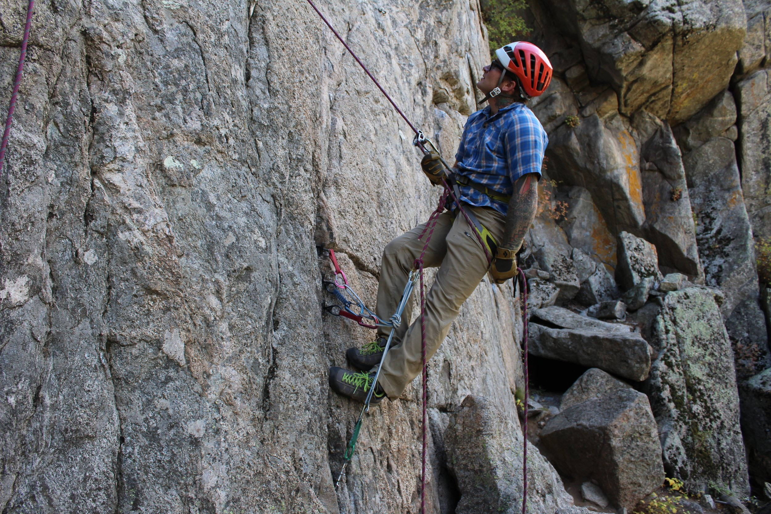 Modern anchors are configured to secure belayers no matter who they are belaying.  They might be belaying a second; they might be belaying a leader.