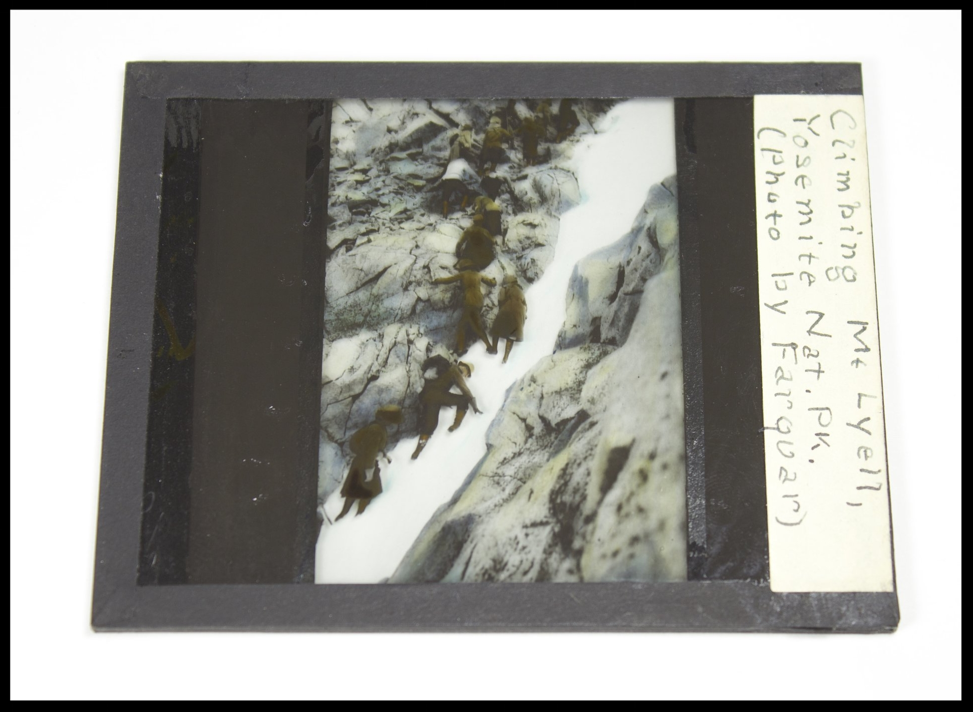 A Lantern Slide Close-Up. Caption reads:  Climbing Mt. Lyell, Yosemite Nat. Pk. (Photo by Farquar) . This slide came from Francis P. Farquhar. It is probably from the 1910-20s.