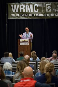 Scott Smith speaking at a gathering of the Wilderness Risk Management Conference. He was chair of the conference for three years.