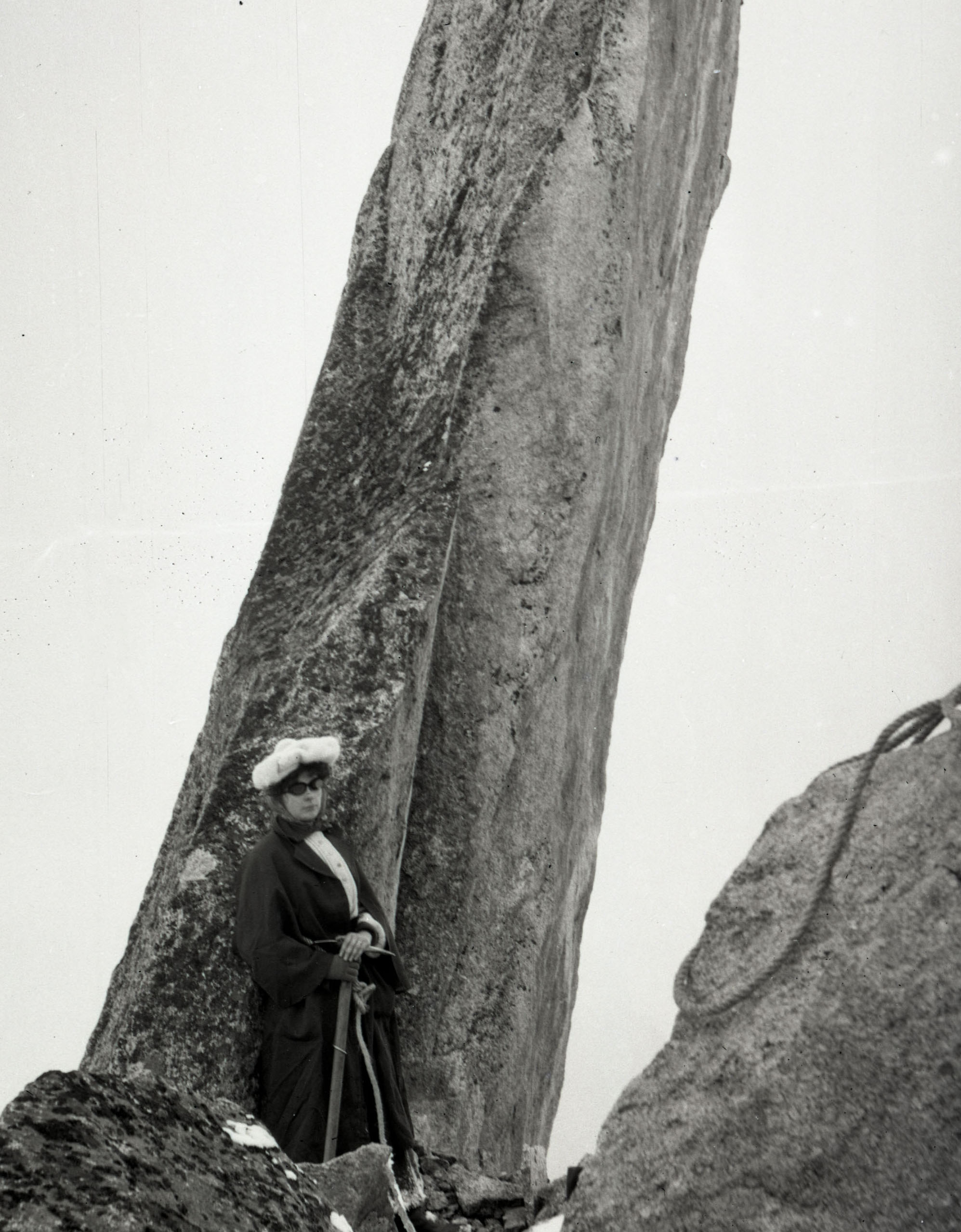 A woman summiting in the Alps circa 1911