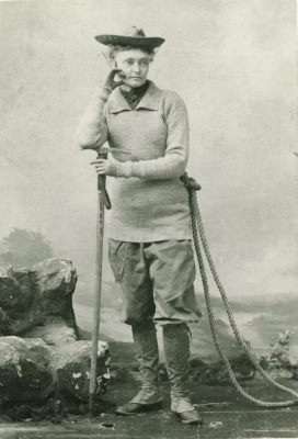 Annie Peck, professional mountaineer, wearing her mountaineering attire in a promotional photograph in 1895.