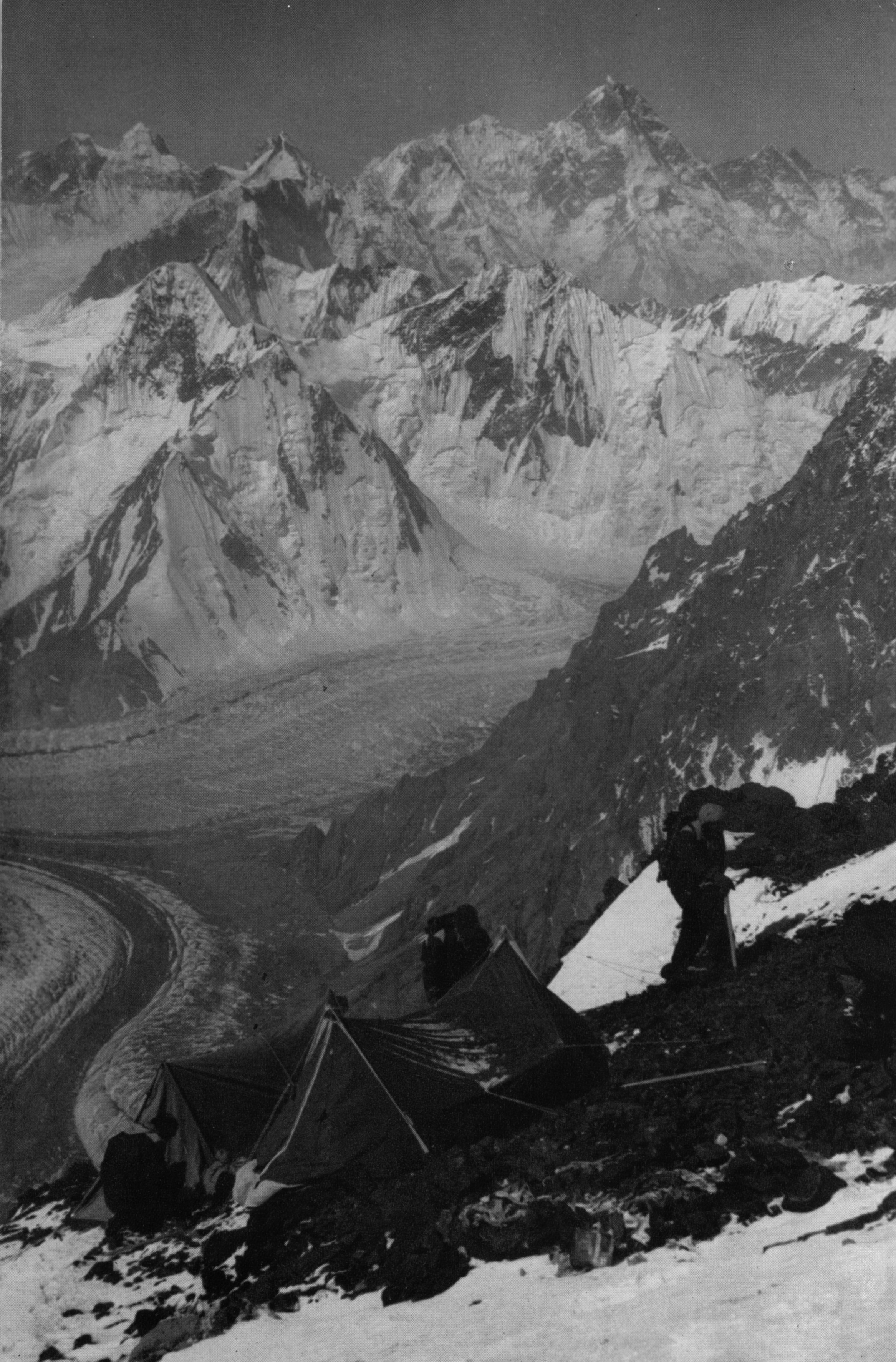 Camp V (22,000 ft.) with Mashrabrum [sic] in the background.  Photo, Third American Karakoram Expedition .