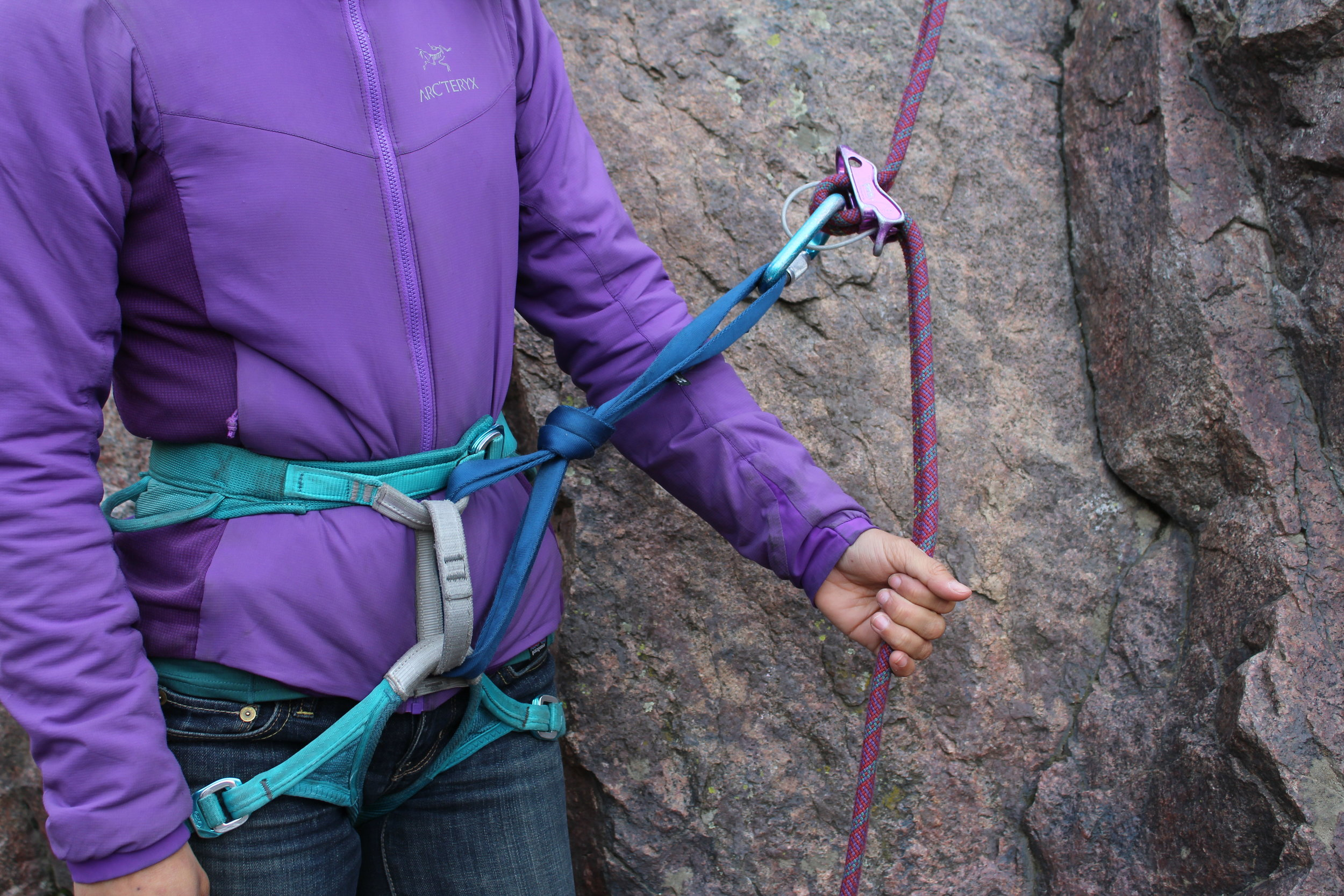 An extension built with a double length nylon sling positions a rappel device far enough from a belay loop that almost any friction hitch backup will be effective.