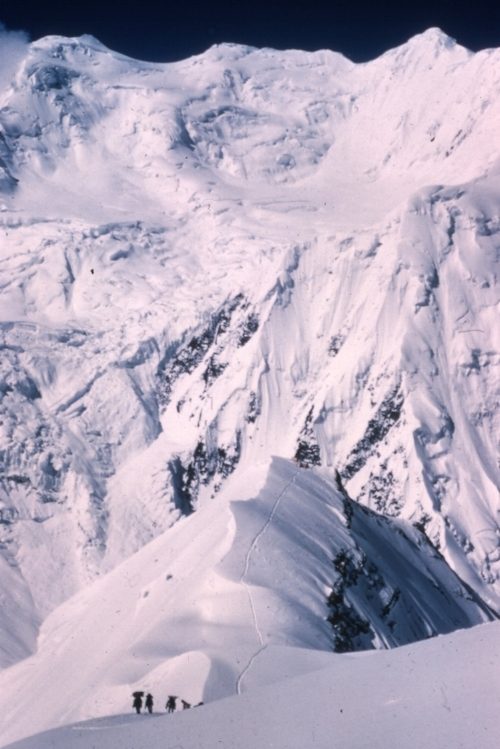 """""""On July 4 all five os us started for Camp V which we hoped to establish at the 24,000-foot col between the south summit and the main peak"""" (Schoening, 1959)."""