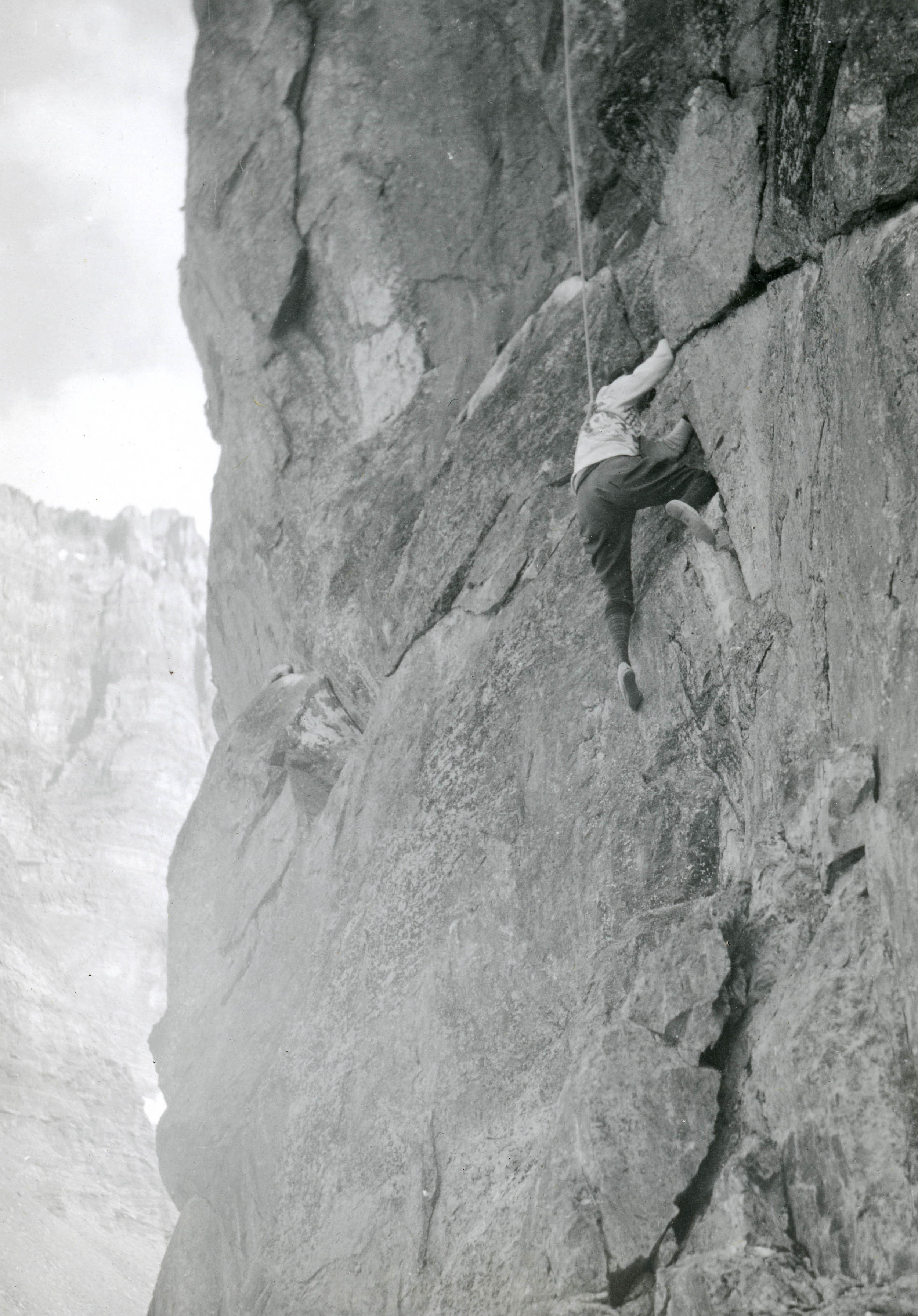 A woman makes her way up a rock face
