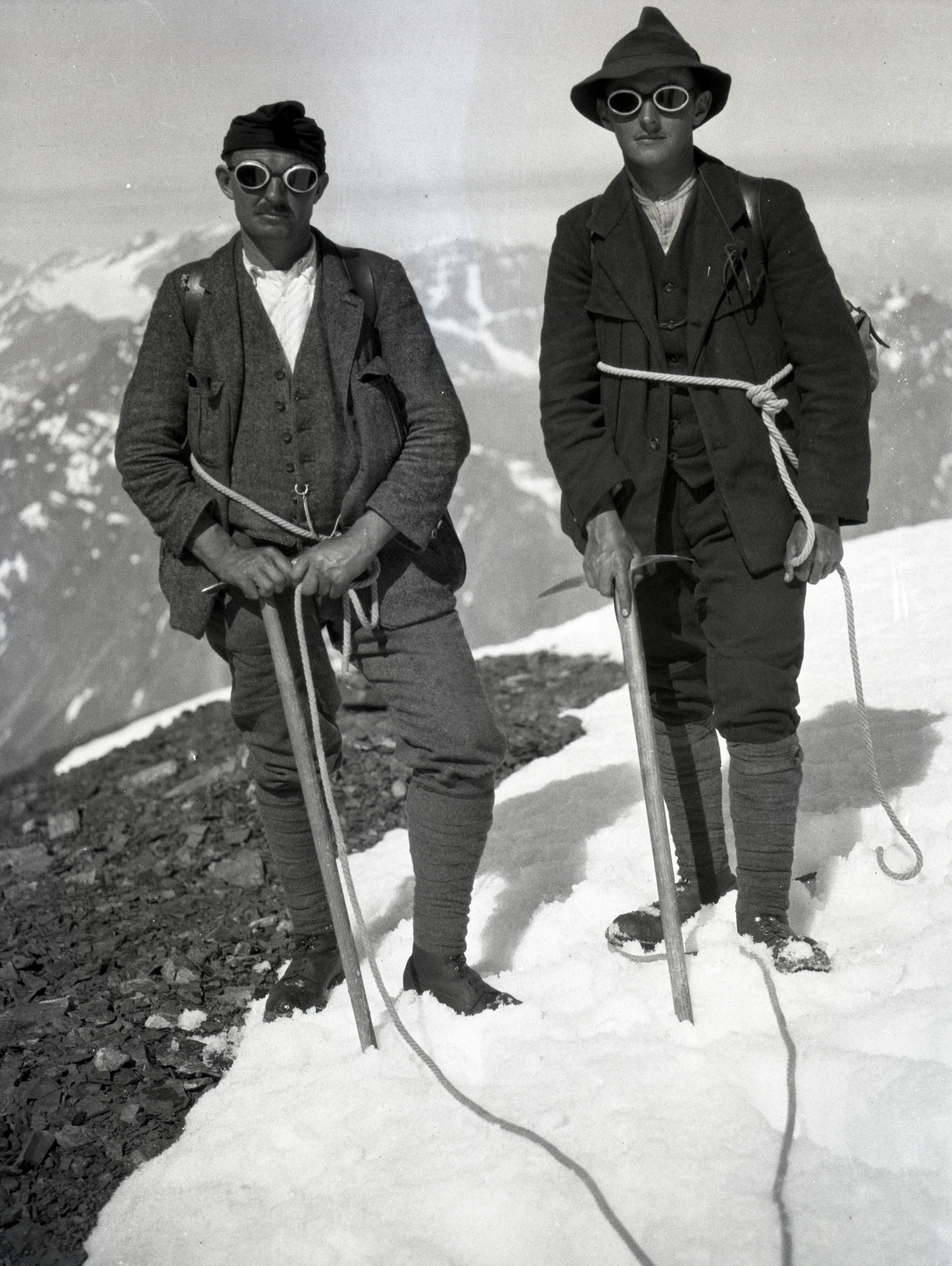 Hemp rope, ice axes and glacier goggles. These two climbers are also wearing puttees (leg wraps).