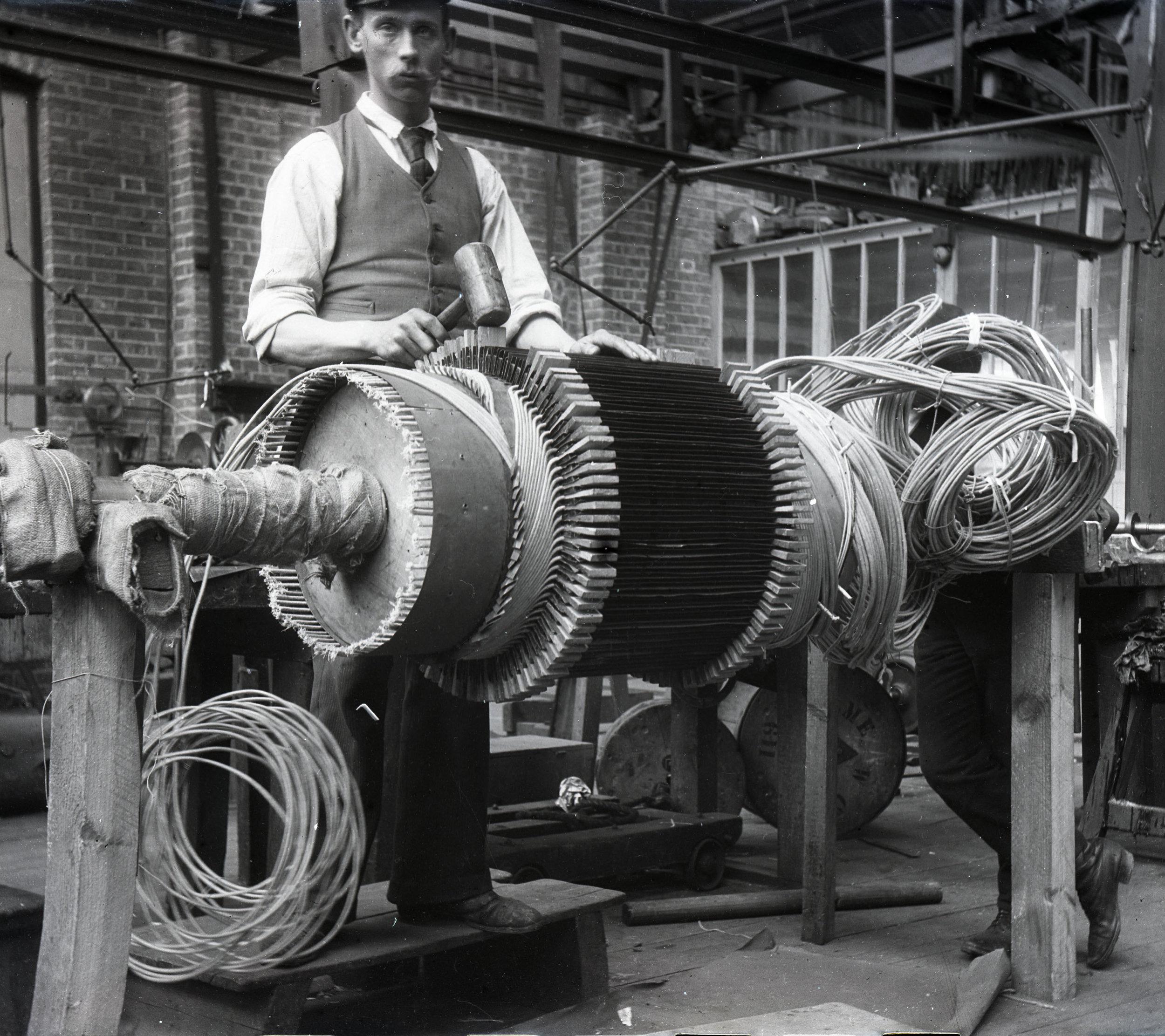 A man winding an armature