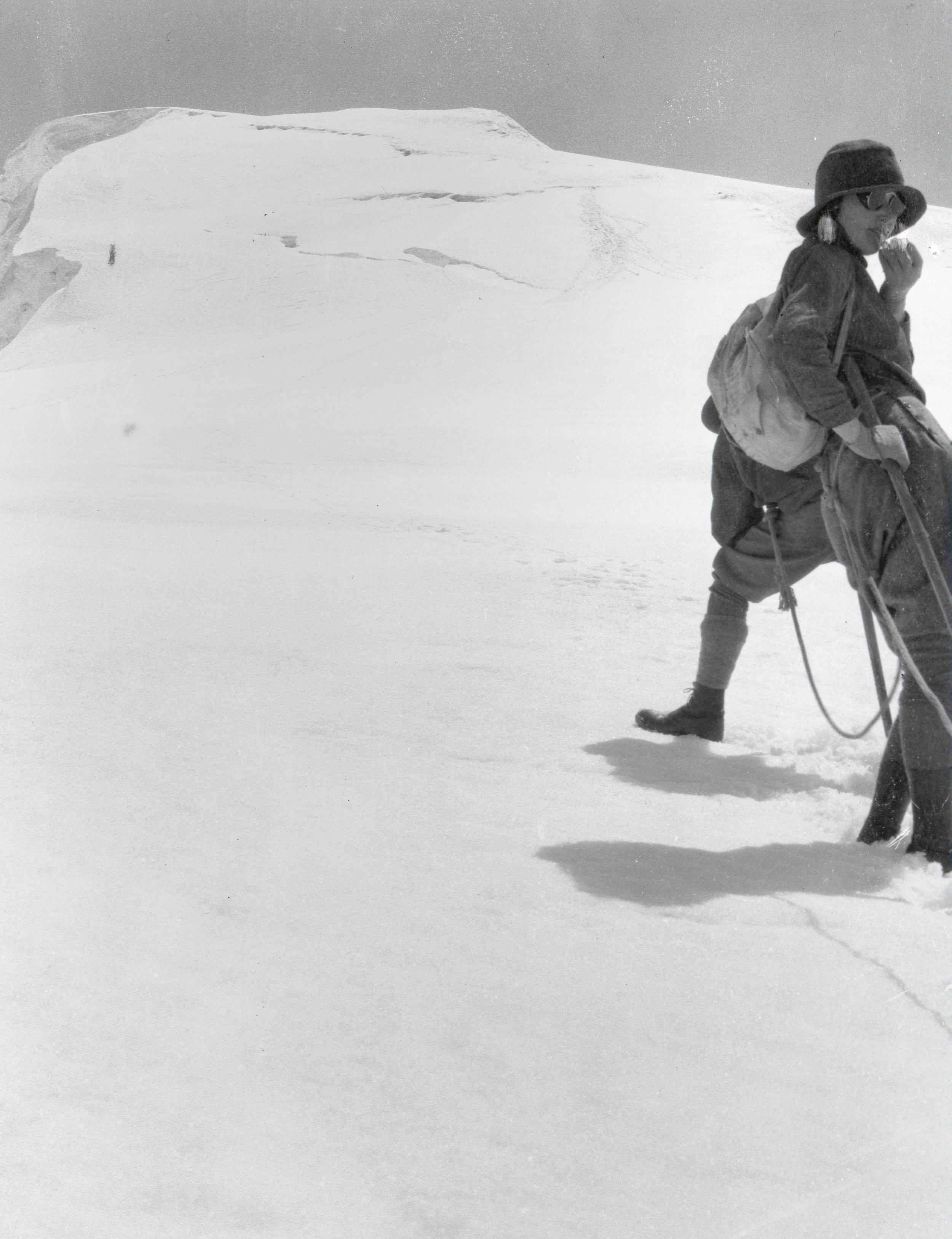 A woman resting against a climbing companion