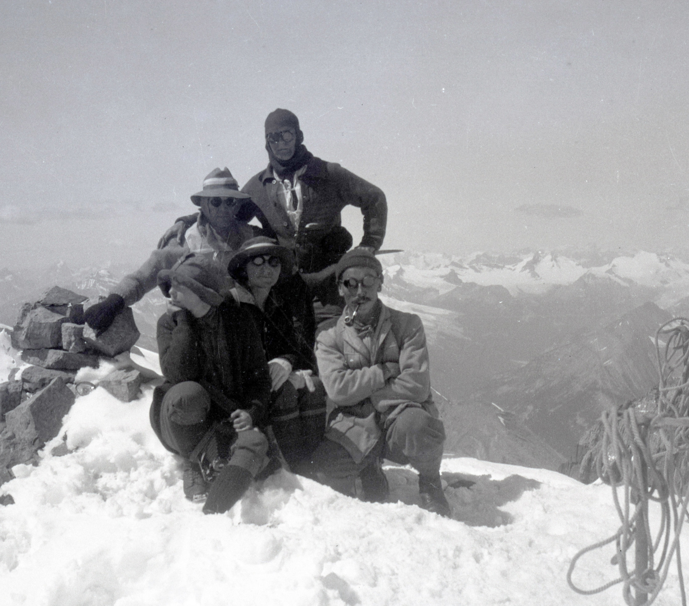 Men and women on the summit of Mount Victoria