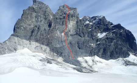 Above: The line of Shaa Téix'i (1,300m, 5.11a) on the west face of Devil's Paw. Right: Brette Harrington.