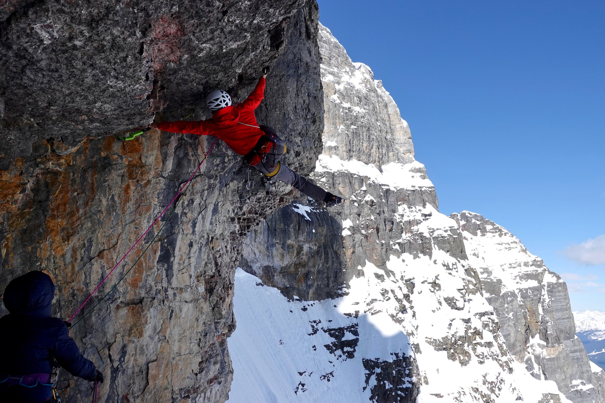 Luka Lindič firing the crux (M8) roof on the direct east face of Mt. Fay.