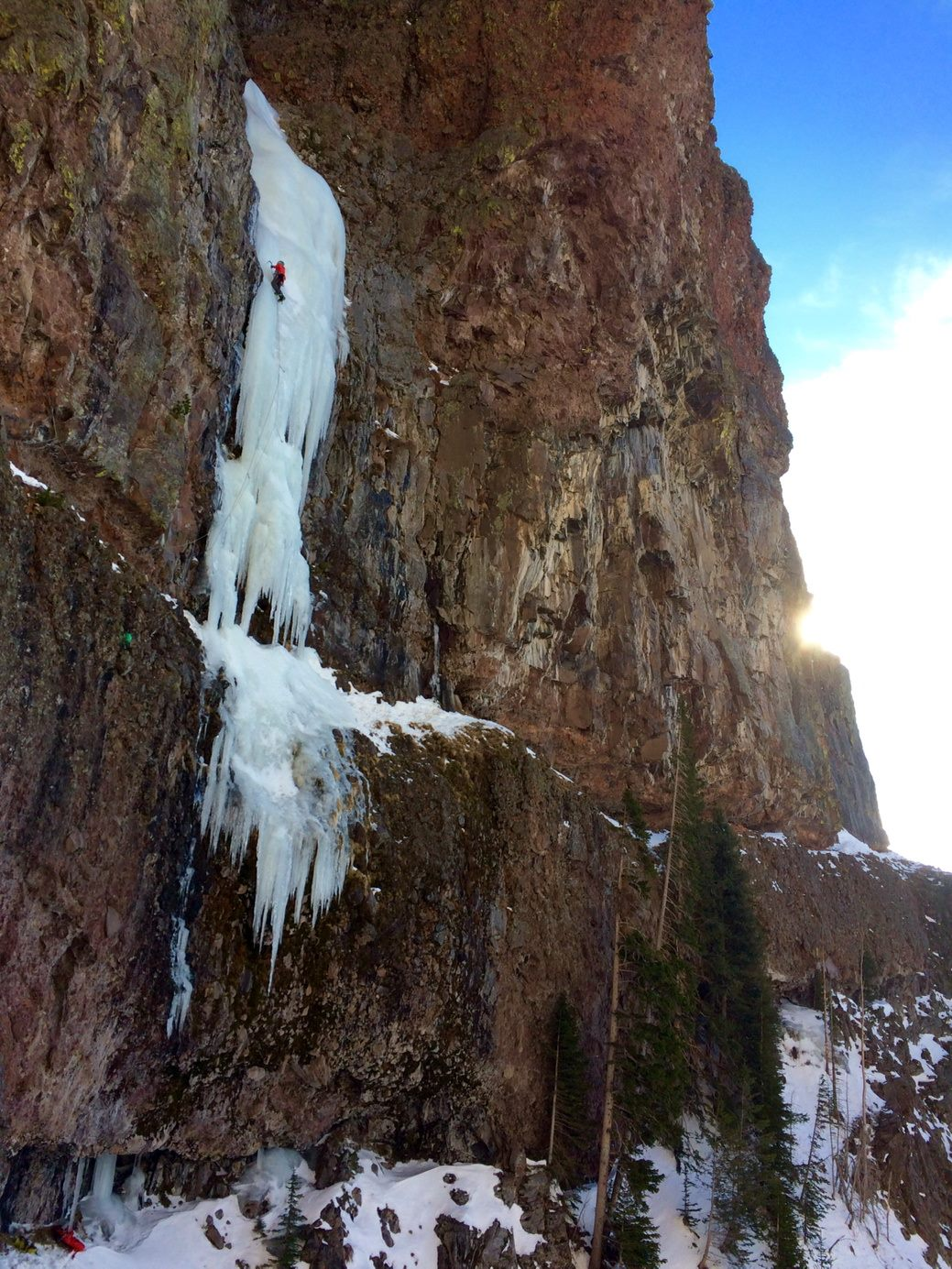 A climber on Responsible Family Man, WI5, in Hyalite Canyon, MT during the Bozeman Ice Festival. Photo Credit: Alden Pellet