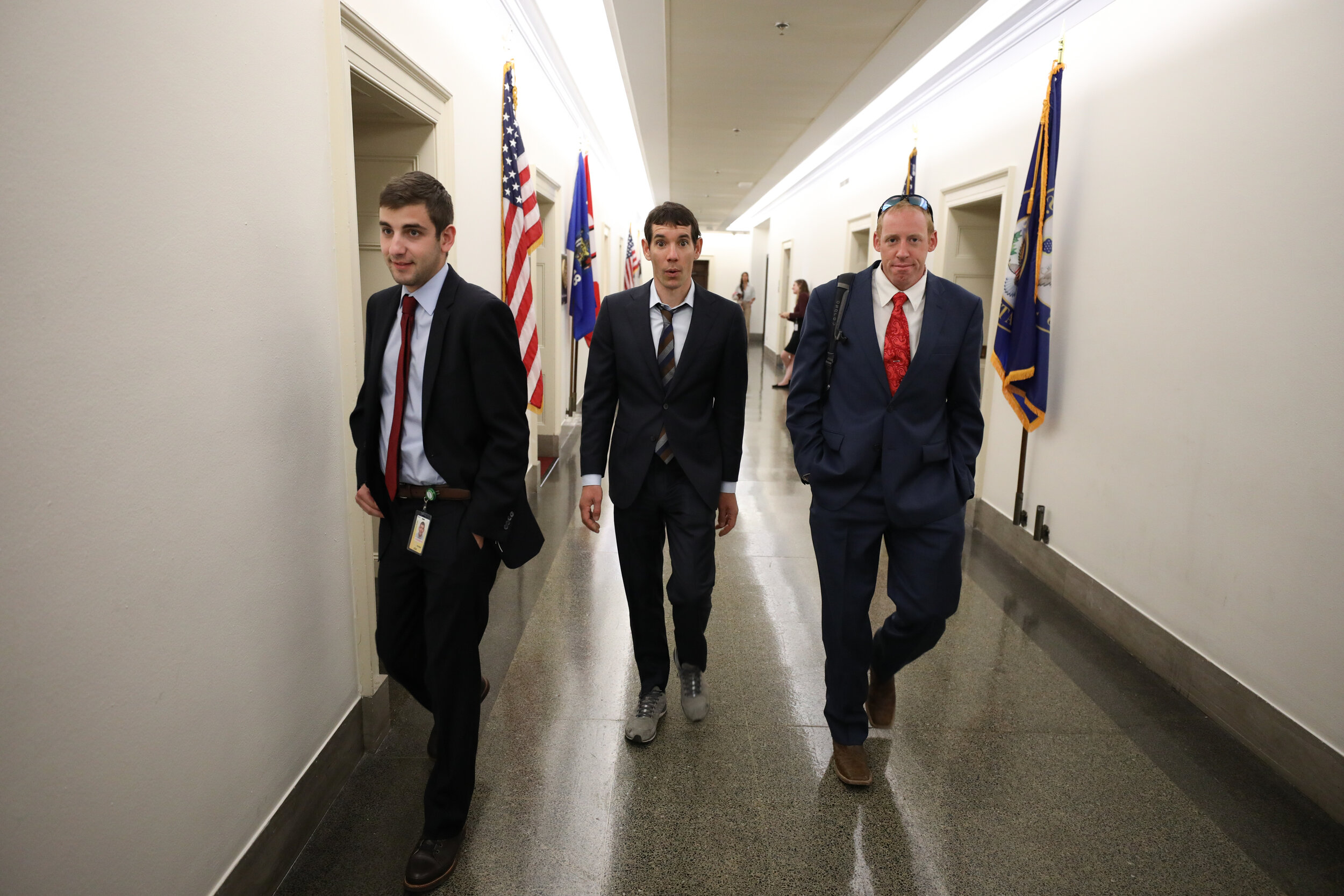 A staffer, Alex Honnold, and Justin Napolitano approach a meeting. Photo © Stephen Gosling.