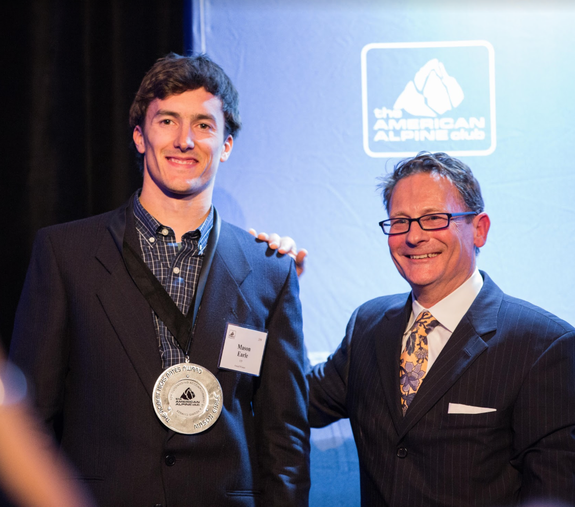 Powers with climber Mason Earle at AAC's Annual Dinner (photo: Jim Aikman).