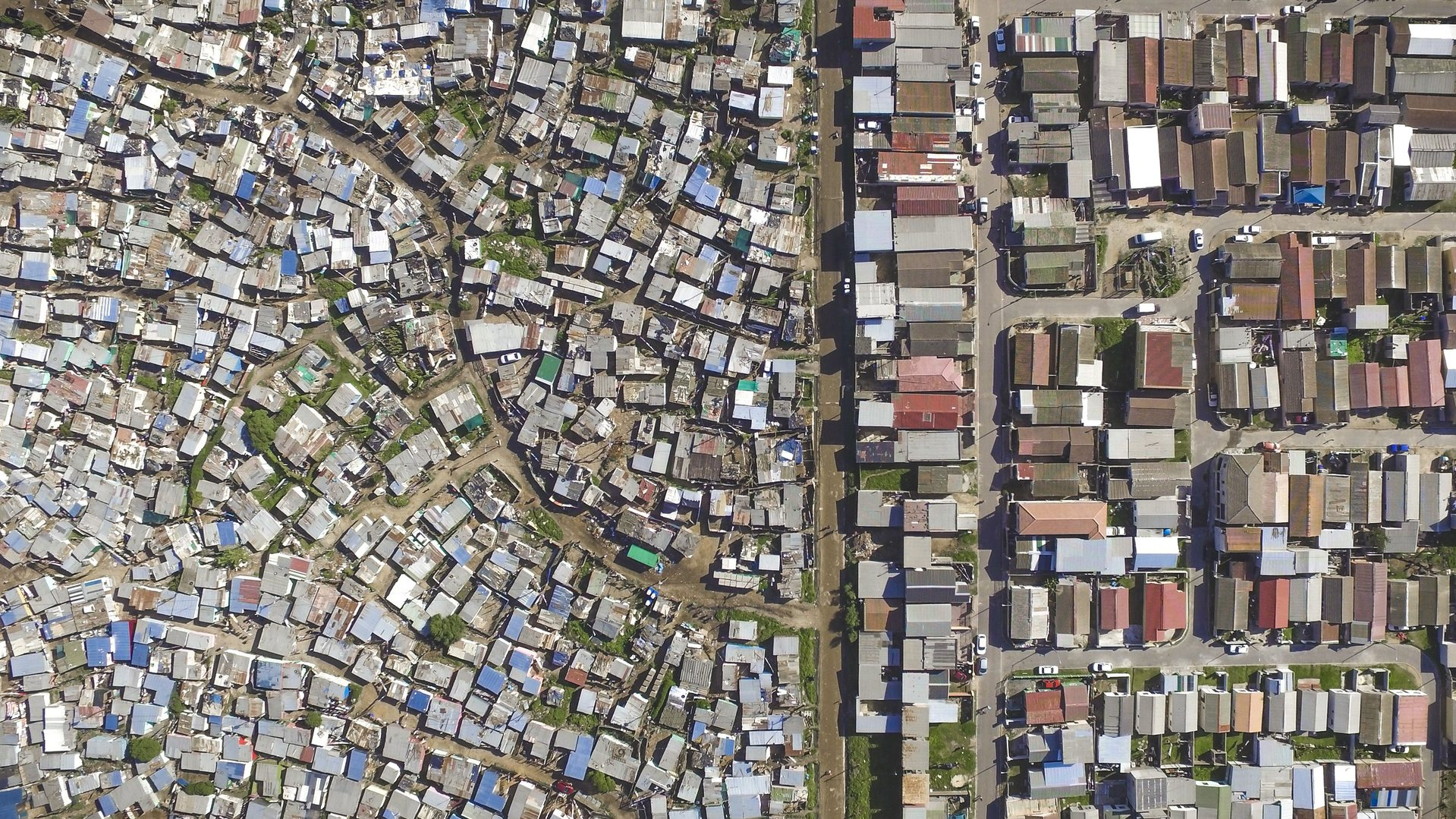 Lotus Park / Mannenberg (Top) and Vukuzenzele/ Sweet Home Farm (Bottom) by Johnny Miller