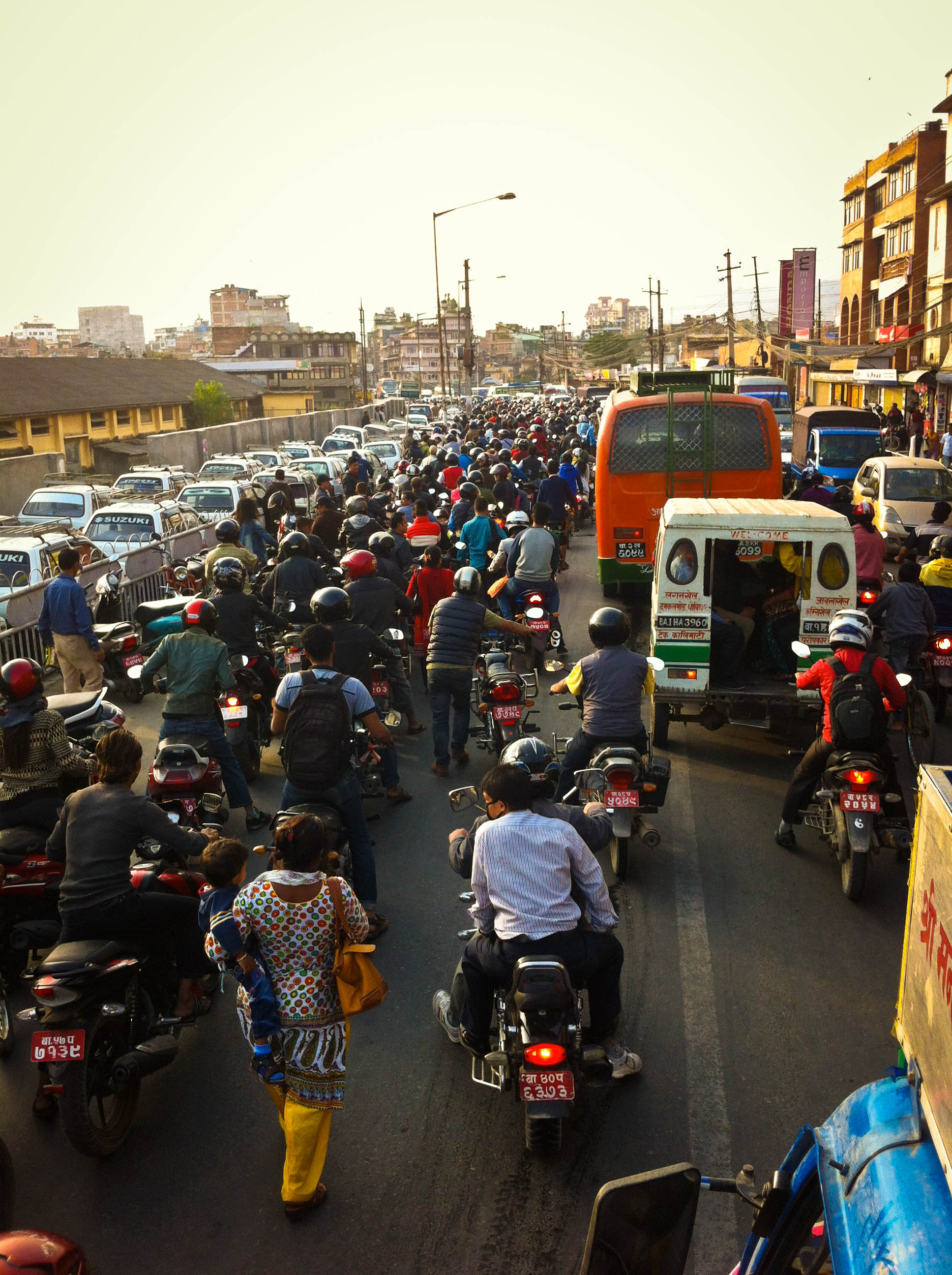 View of the cue for petrol at a station in Teku, Kathmandu. Our delivery truck had to wade through the waves of traffic for hours to finally move onto the highway to Makwanpur.