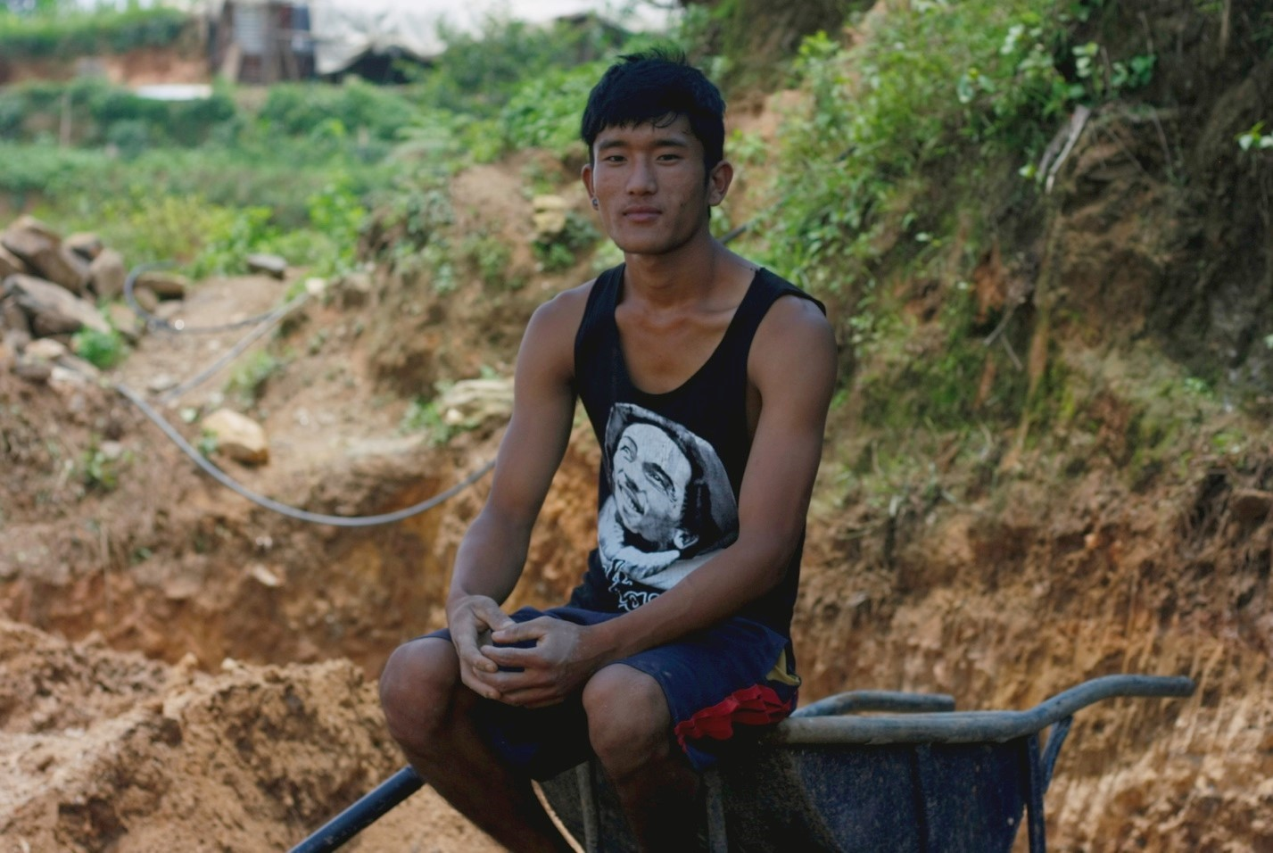 Gopi Tamang on the new patch of land he is helping to make level for the construction of his new house
