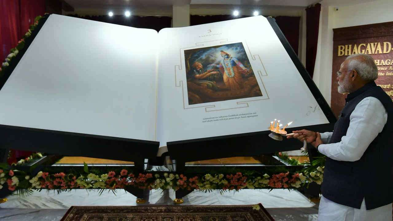The Indian Prime Minister, Sri Narendra Modi, unveils the Bhagavad Gita, prepared by ISKCON devotees as a gift to the world, at ISKCON New Delhi on February 26, 2019.