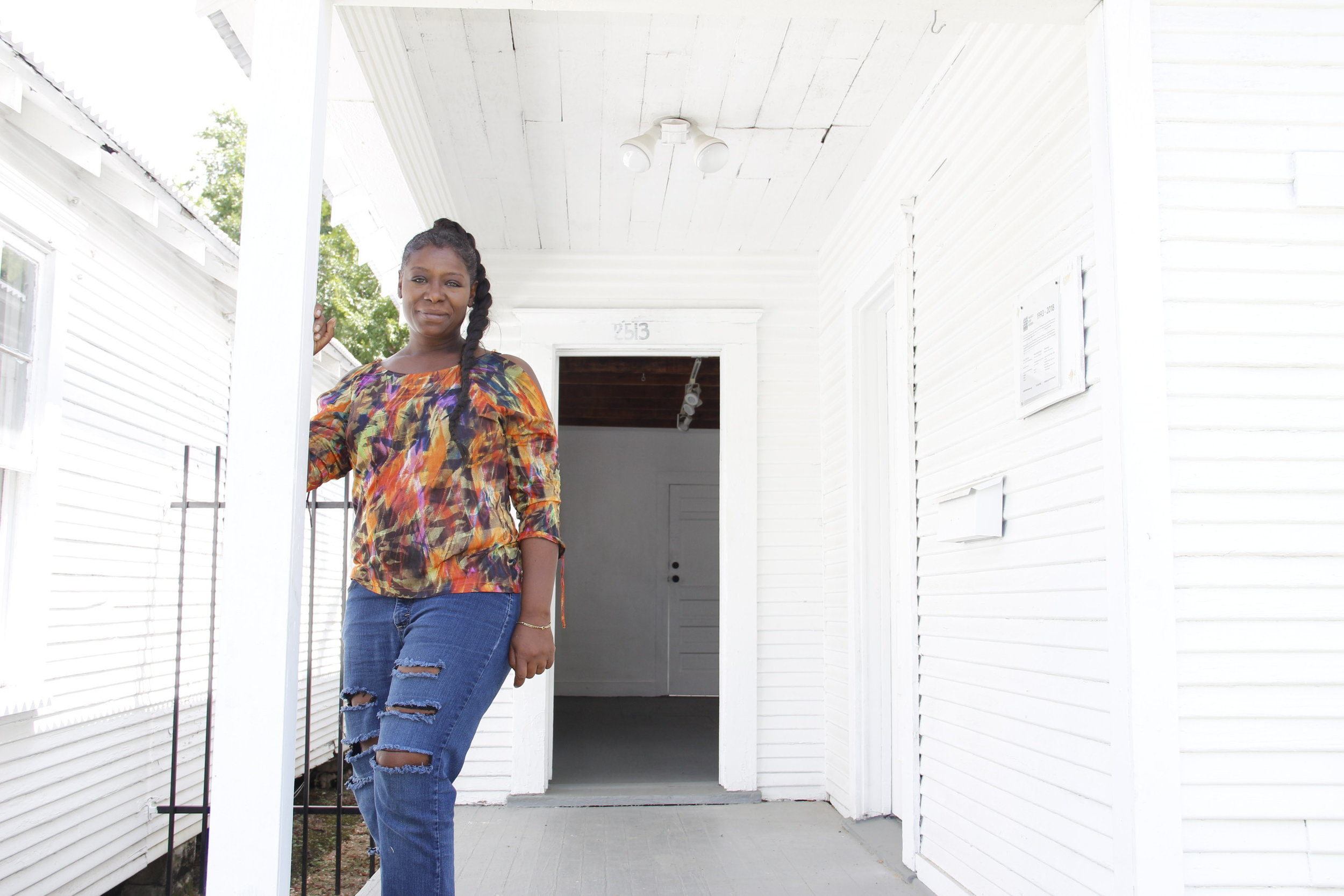 Catherine Davila on the porch of her art house