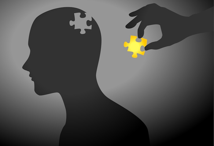 Silhouette of man, other person adding missing piece to puzzle.
