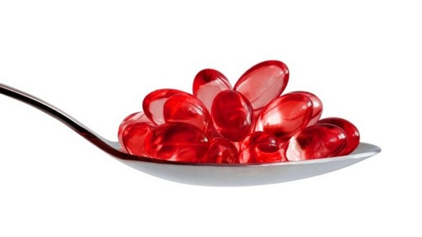 A spoonful of krill oil capsules. Krill oil contains omega-3 fatty acids, which have been shown to increase BDNF.