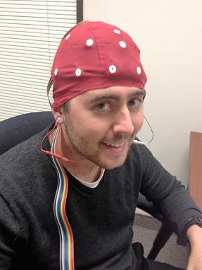 Jordan Fallis wearing QEEG brain mapping neurofeedback cap.