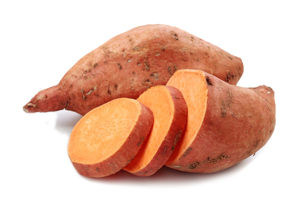 A whole sweet potato and a cut up sweet potatoe. Sweet potatoes are a healthy course of carbohydrates that can support your health and help you fight brain fog.