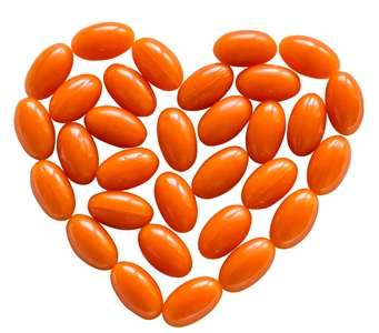 CoQ10 supplement pills in the shape of a heart. CoQ10 is depleted by psychiatric drugs.