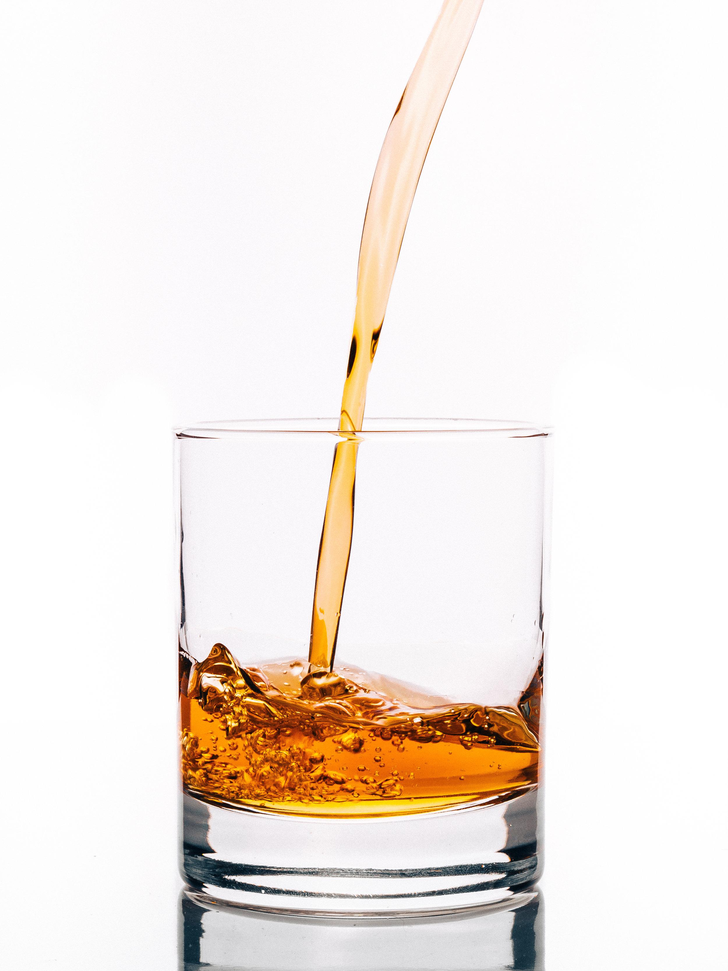 Liquor being poured into a glass.